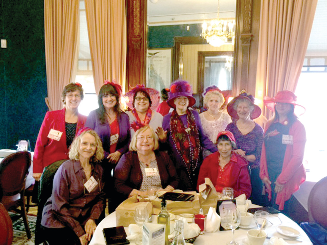 PLAYGROUP FOR WOMEN: Rhody Red Hatters enjoy lunch together.