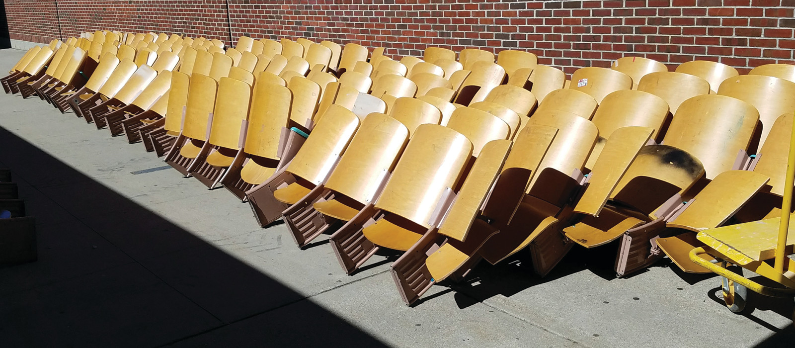 IF THESE SEATS COULD TALK: The auditorium seats lined the Cranston West walkways, waiting to be taken away. These same seats have seen 54 years of students sitting in them for school-wide events and community happenings, with generations of people utilizing the space for nearly 60 years.