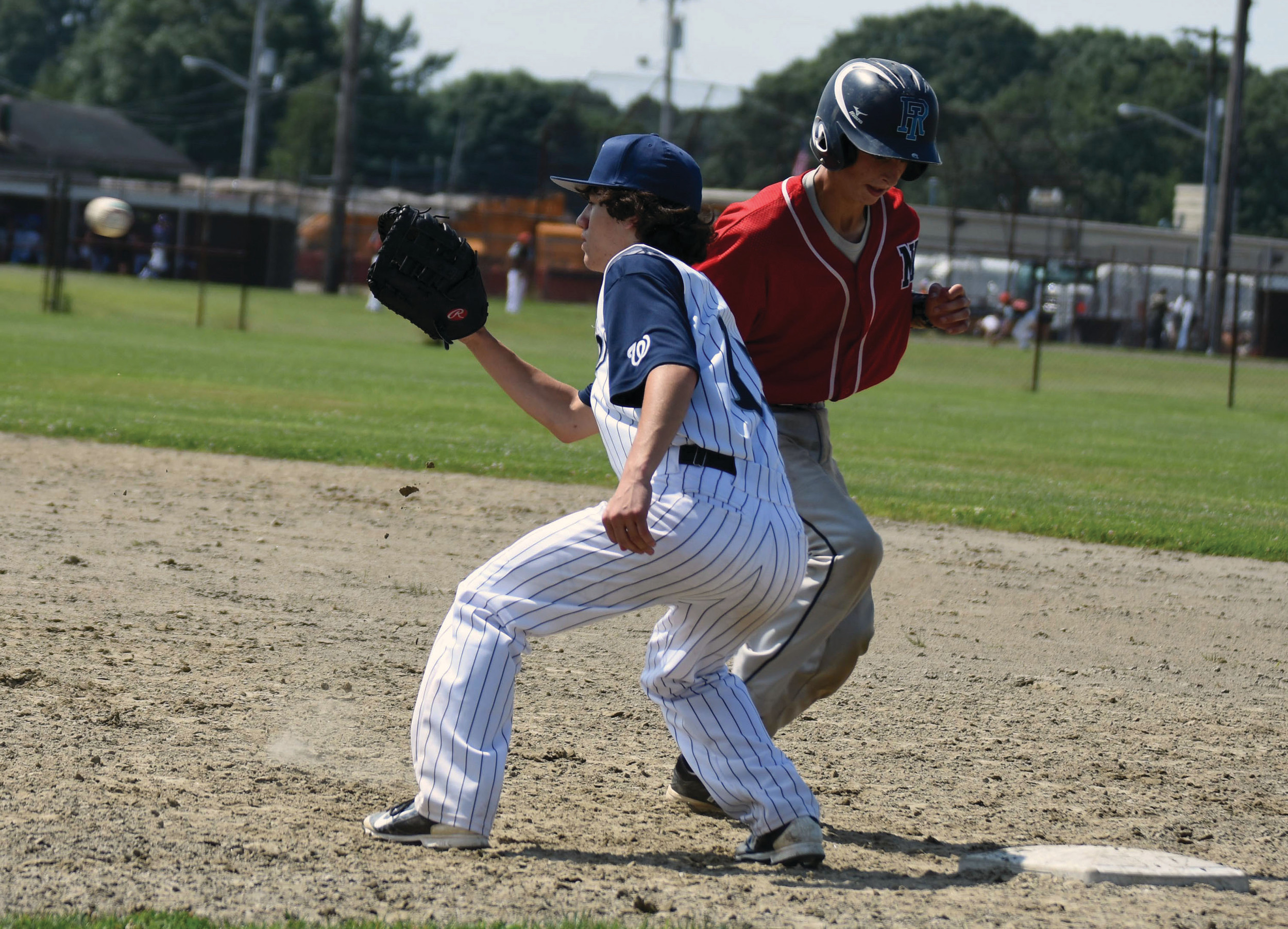 SHUTOUT: Warwick PAL improved to 3-2 in the Connie Mack standings with a 9-0 rout of the Narragansett Lions on Saturday at Mickey Stevens. Above, first baseman Derek Lallo waits on a pick-off throw.