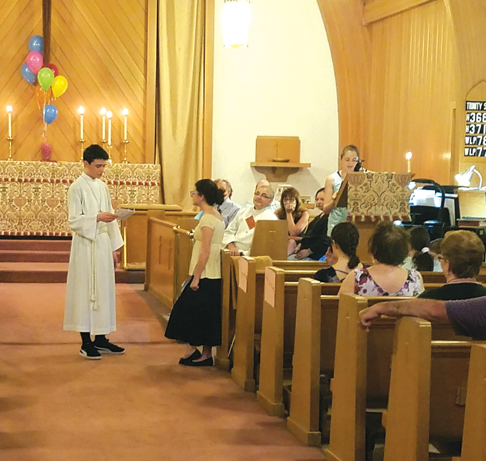 THE LIFE OF ST. DAVID: High school student Alexander Pate and middle school student Mia Boscia help their fellow Sunday School students to tell the story of St. David as parishioners look on.