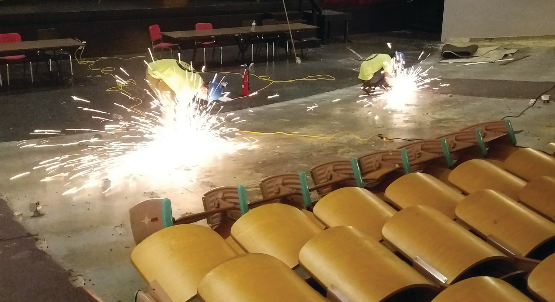 OUT OF THE CLASSROOM AND ON THE JOB: Sparks were flying on June 22 at Cranston West as the newest graduates from the New England Laborers'/Cranston Public Schools Construction Career Academy put their education to the test, using the skills they learned in school on their first official job site.