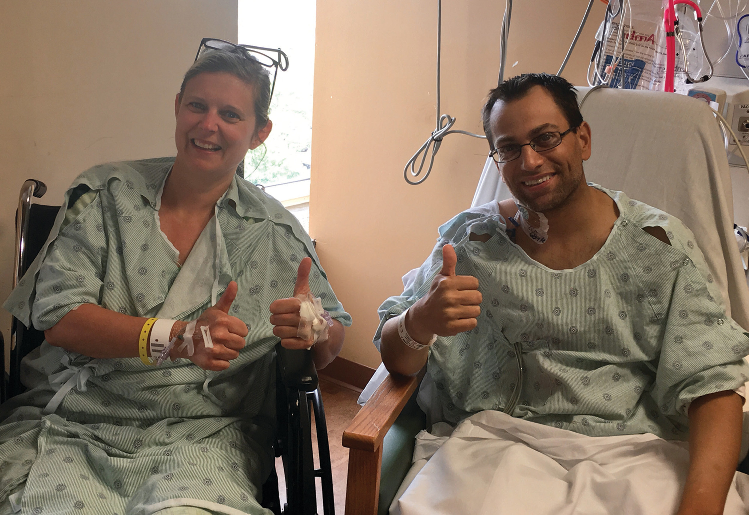 A PERFECT MATCH: Michelle Sheehan-Pimental and Ryan Mullen meet for the first time in the recovery room at Rhode Island Hospital after their successful transplant surgery.