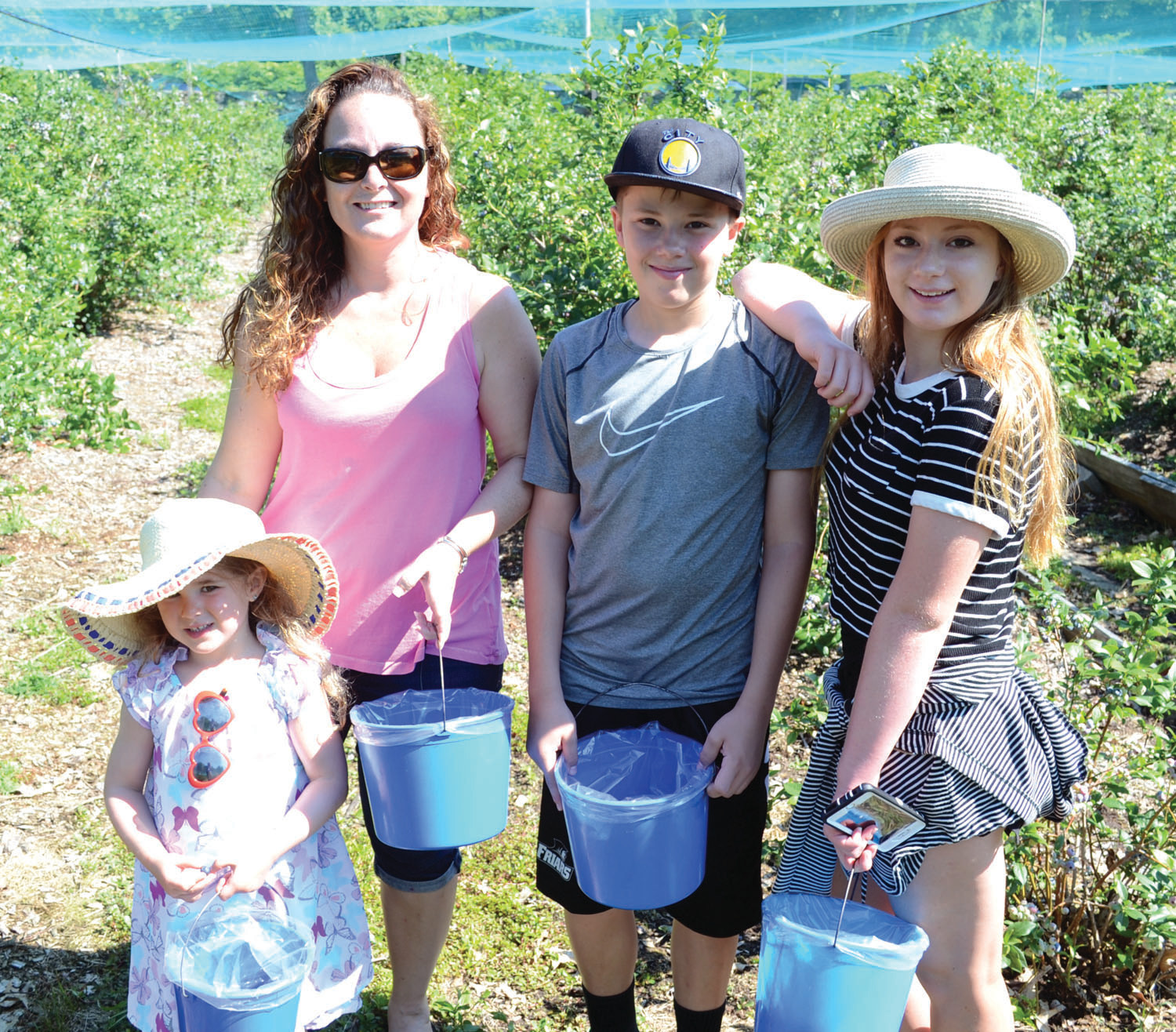 FAMILY OUTING: Aundrea Jemma, Bobbie-Jo Jemma, Justin Bianchi and Janelle Bianchi enjoying a beautiful day picking berries.