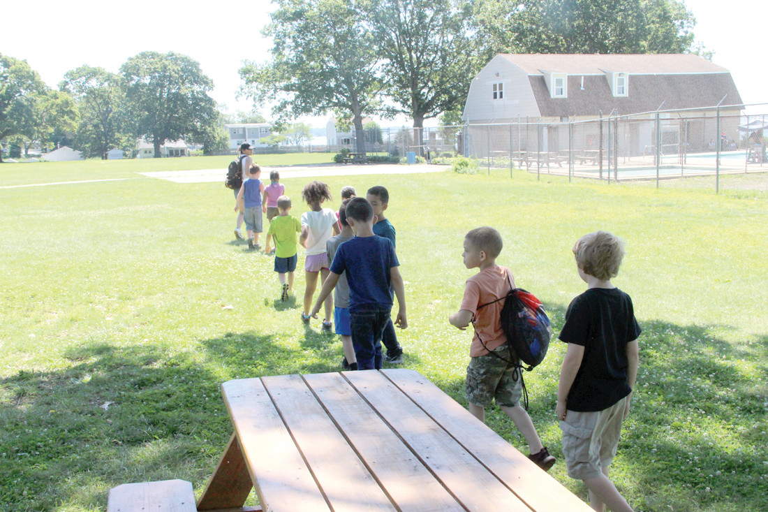 TRANSITION: Campers leaving the STEM station and making their way to H20 on the bayside grounds of the Masonic Youth Center in Buttonwoods.