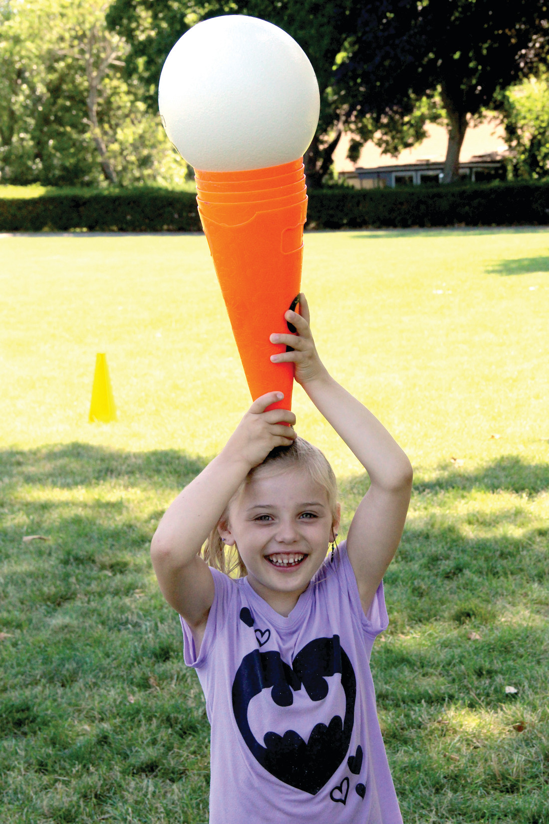 HEY, CONEHEAD: Camper, Madison Kinne smiles for the camera as she demonstrates her balancing ability.