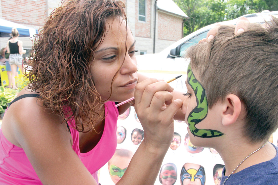 IT HAD TO BE AN ANIMAL: Jessica Bryant paints a snake on the face of Jameson Brittain at Saturday's show. Jameson didn't budge as Jessica worked her creativity.