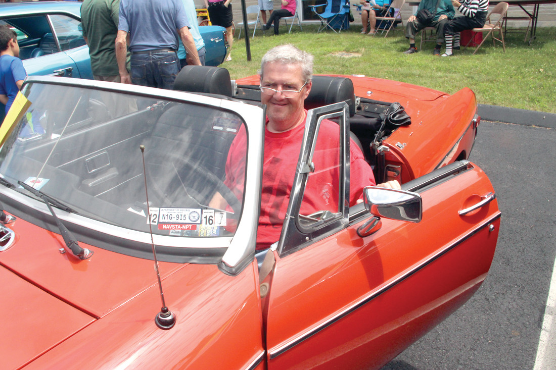 DRIVES IT ALL THE TIME: Russ Smith brought his 1976 MG-B Roadster to the show. The car belonged to his late father, Ken Smith, and driving it reminds Russ of his dad. Russ drives the car everywhere. It's like bringing his father along. His aunt, Nancy Peterson, a resident of the nursing home came out to get a glimpse of the sporty vehicle.