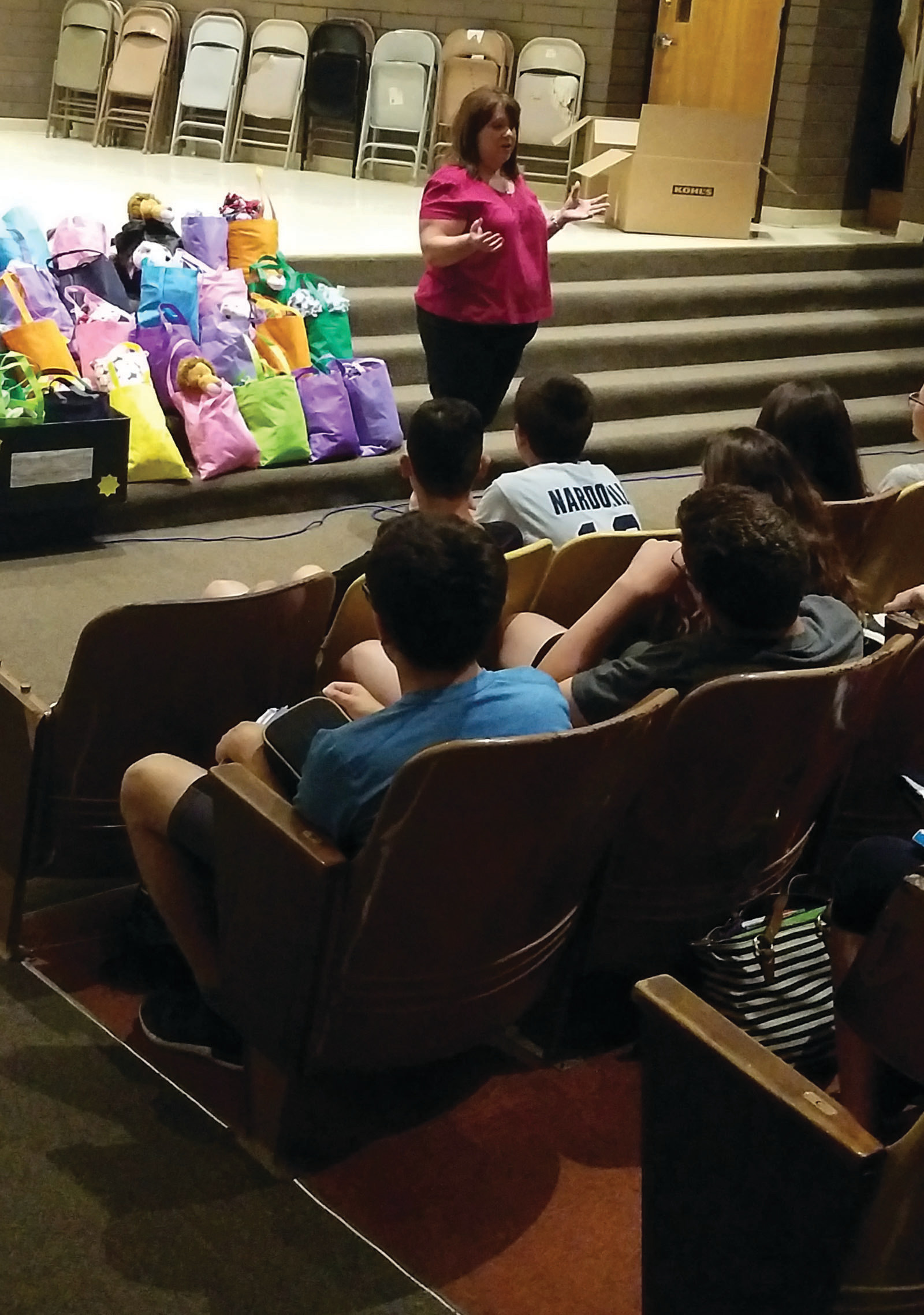 WHAT WE DO, AND WHY WE DO IT: President of Social Services for CCAP, Joanne Gregory, speaks to the students about the role that CCAP plays in helping residents get the resources they need.