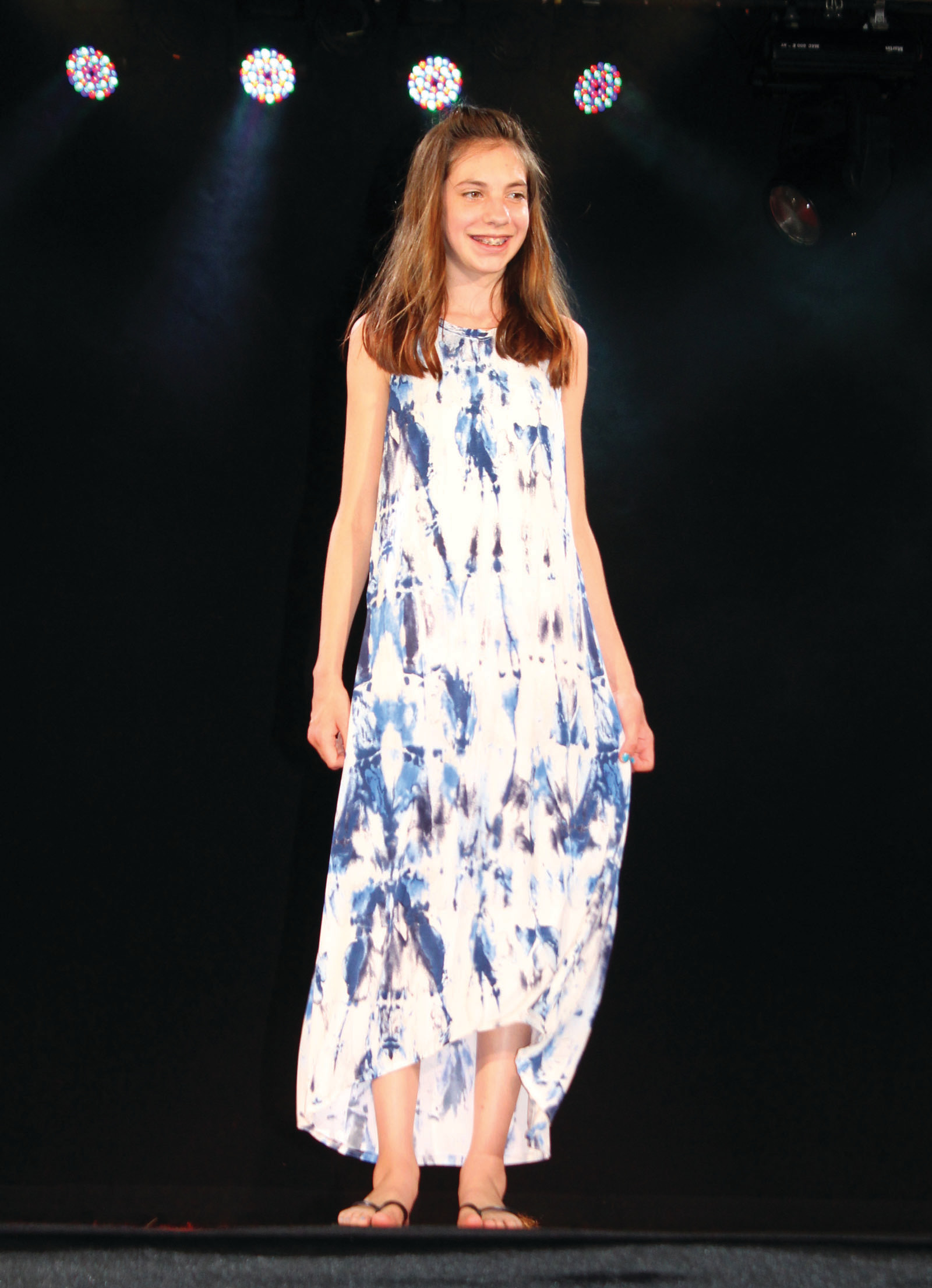 A NEW DRESS FOR SUMMERTIME: Amber Prior walked the runway in a dress she worked on throughout the school year.