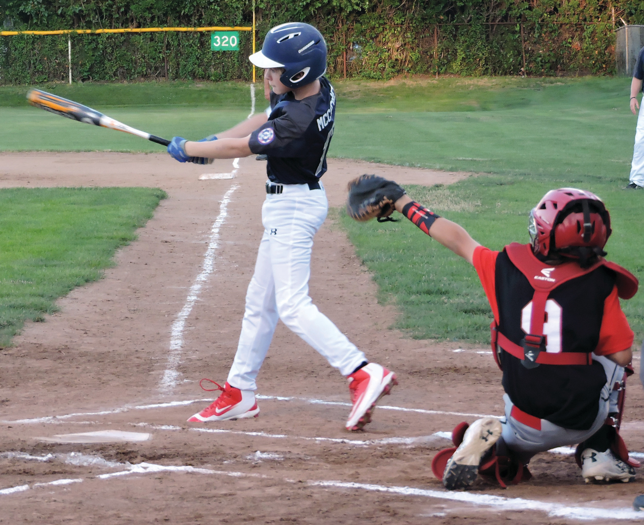 AGGRESSIVE AT THE PLATE: Brendan McCaffrey attacks a pitch in the zone.