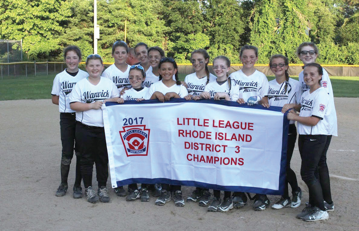 ON TO STATES: The Warwick North 11/12-year-old all-star team gathers around its District 3 title banner on Wednesday.