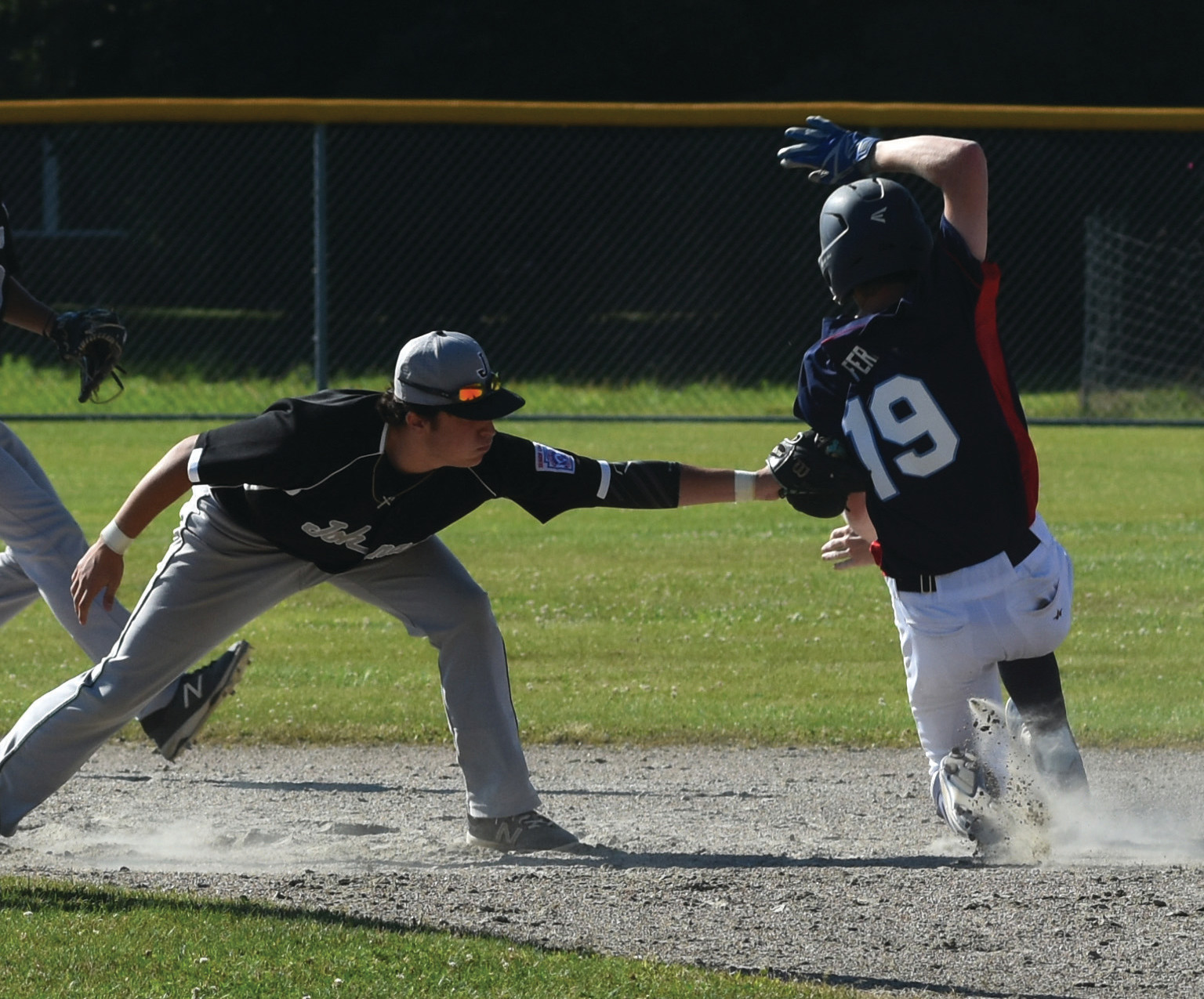 TITLE GAME BERTH: Miguel Perez tags out a South Kingstown base runner at second.