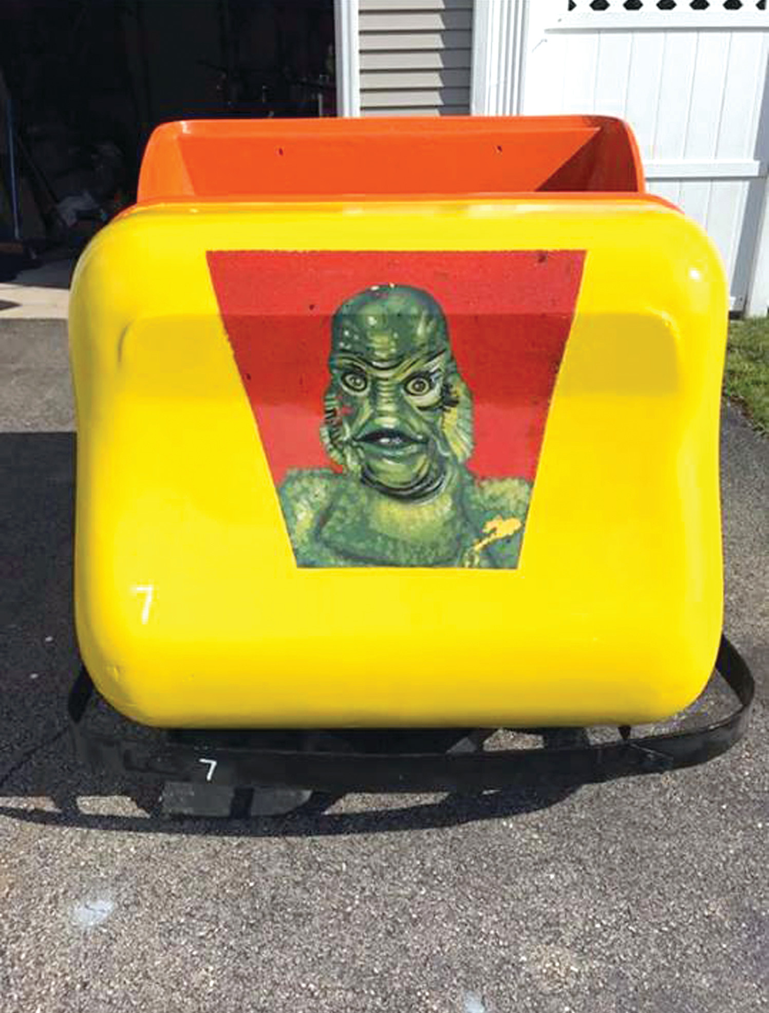 AFTER: The gleaming Creature from the Black Lagoon car after being restored. The artwork pictured on the front is original.