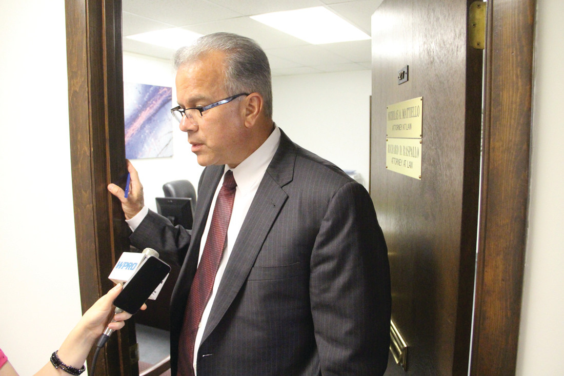 Nicholas Mattiello talks to reporters outside of his law office on Tuesday in response to a few protesters asking him to reconvene the House and finish the state budget.