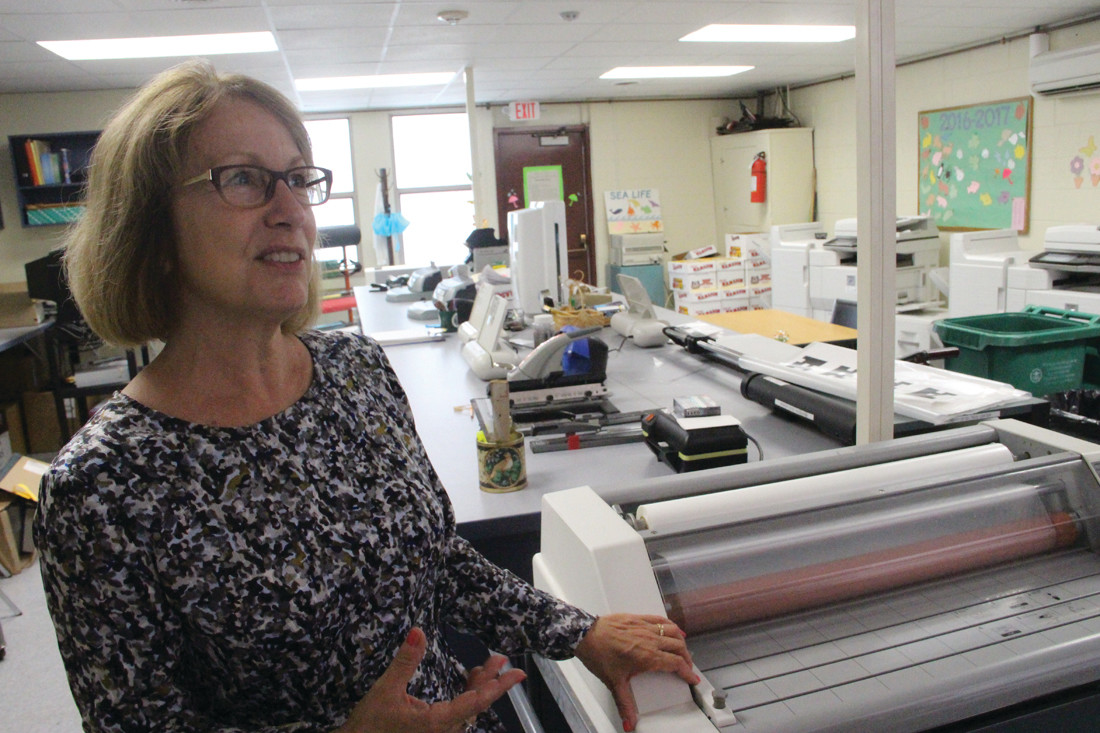 UP AND OPERATING: Deborah McGovern, who operates the department's technical printing center, has moved into the annex building behind Gorton.