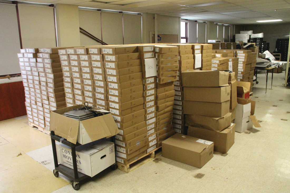 CORDS OF CROMEBOOKS: Chromebooks that will be going to students are stored in one of the many rooms Gorton offers.