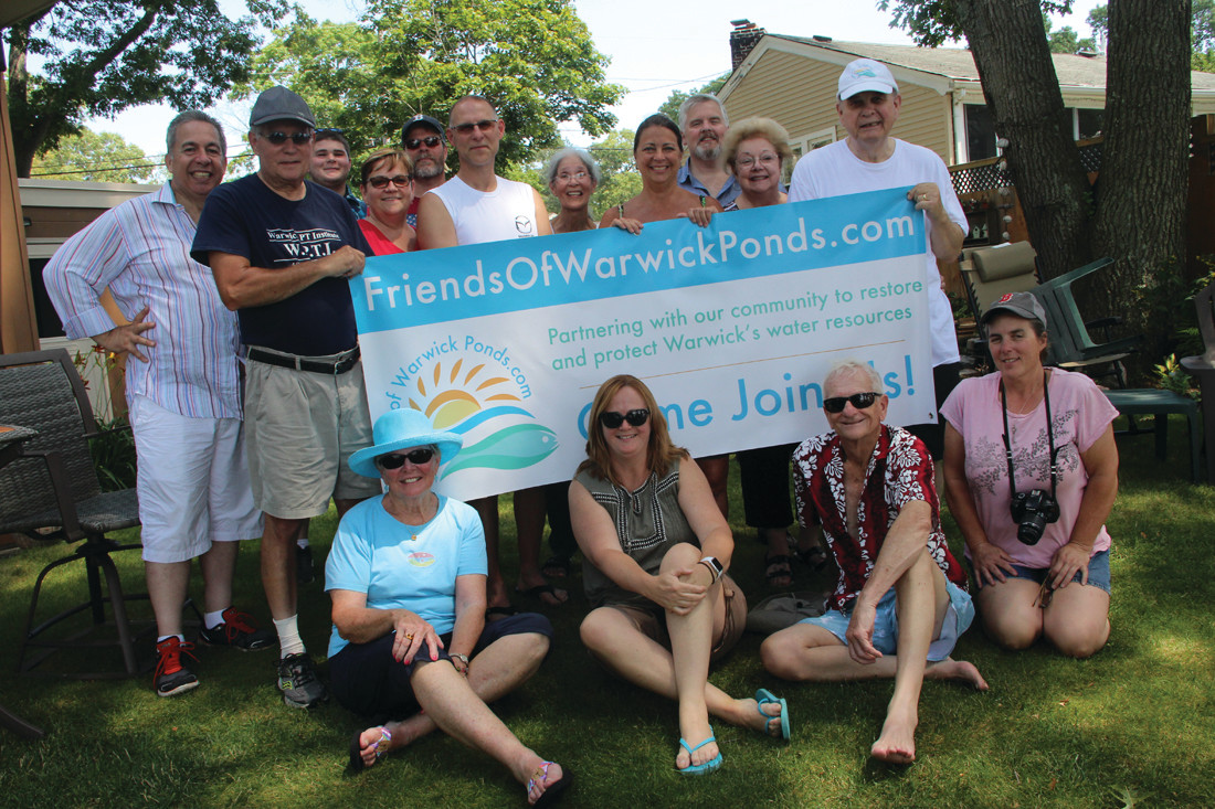 SUMMERTIME MEETING: Members of the Friends of Warwick Ponds gathered at the DeNuccio residence for a picnic after congregating by boat, kayak and canoe at the center of Warwick Pond for a meeting Sunday.