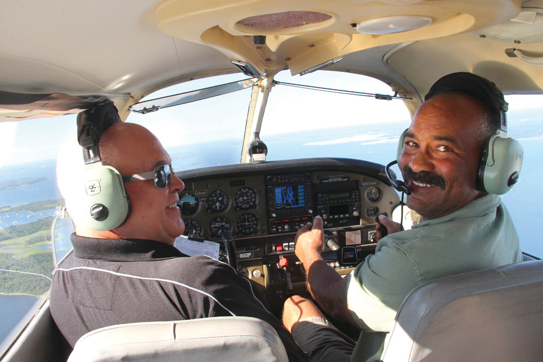 AT THE CONTROLS: Claude Bergeron (left) and Jody King on their way to breakfast at Block Island.