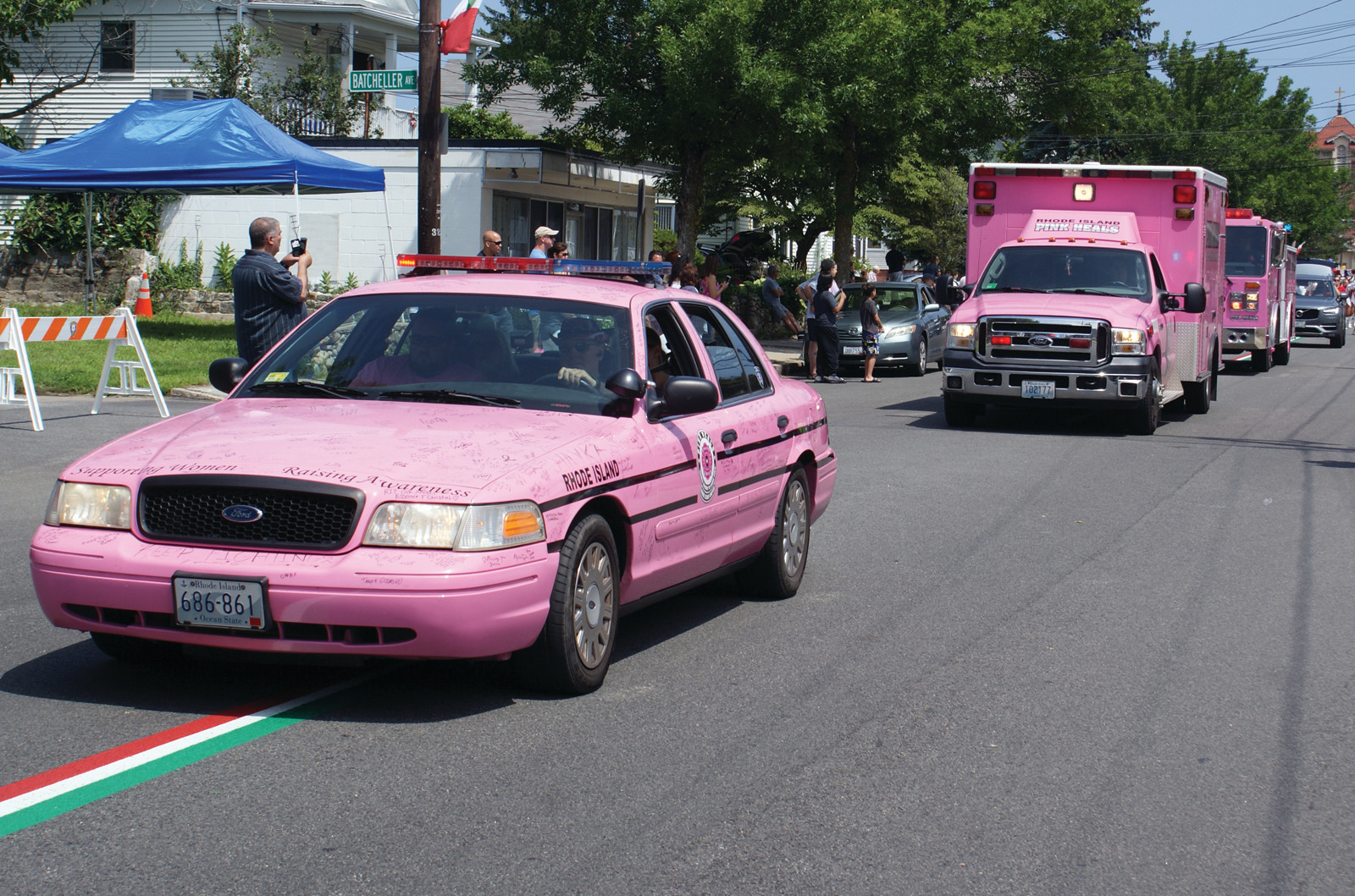 PINK HEALS: The Pink Heals vehicles also took part in the parade, with Susanne leading the charge and Jenna the ambulance in the back. Not pictured is Patricia the fire truck.