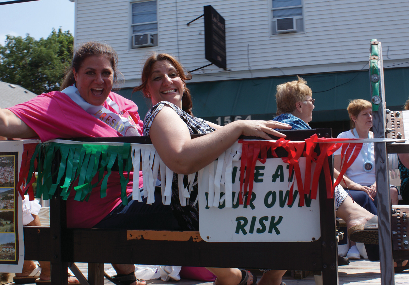 HAVING A BLAST: Maria Manzi, president of the St. Mary's Feast Society Ladies Auxiliary, rode along with friend and Ward 2 School Committee Representative Stephanie Culhane during the parade.