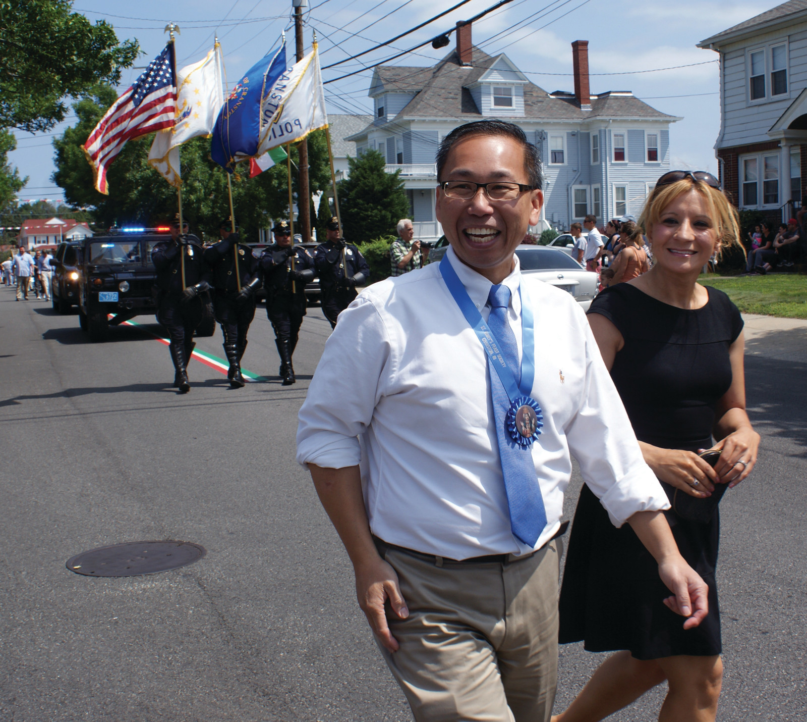 ALL SMILES: Cranston Mayor Allan Fung and his wife, Barbara Ann Fenton, marched in the parade on Sunday.
