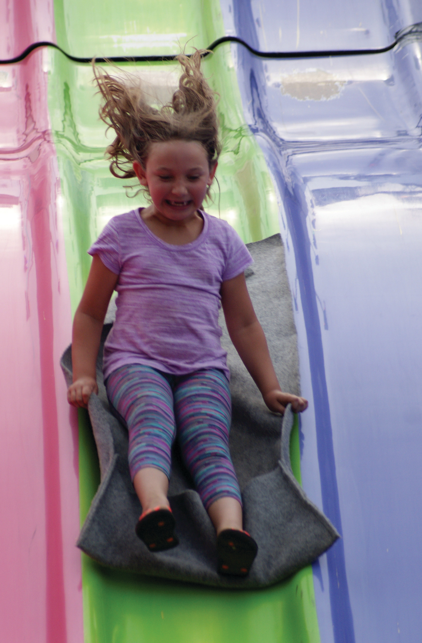 SLIDING INTO THE WEEKEND: Ashlyn Savaria, 7, enjoys the slide at the St. Mary's Feast this past weekend.