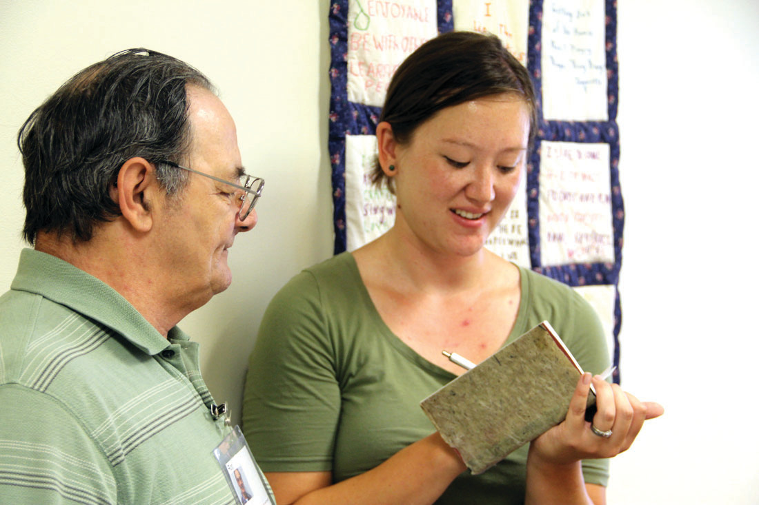 GOOD ON PAPER: May Babcock, an interdisciplinary artist based in Providence, and Ron Lemme observe a handmade paper creation during Babcock's visit to Cornerstone Adult Day Center, a branch of Saint Elizabeth Community, which is a member of the CareLink network.