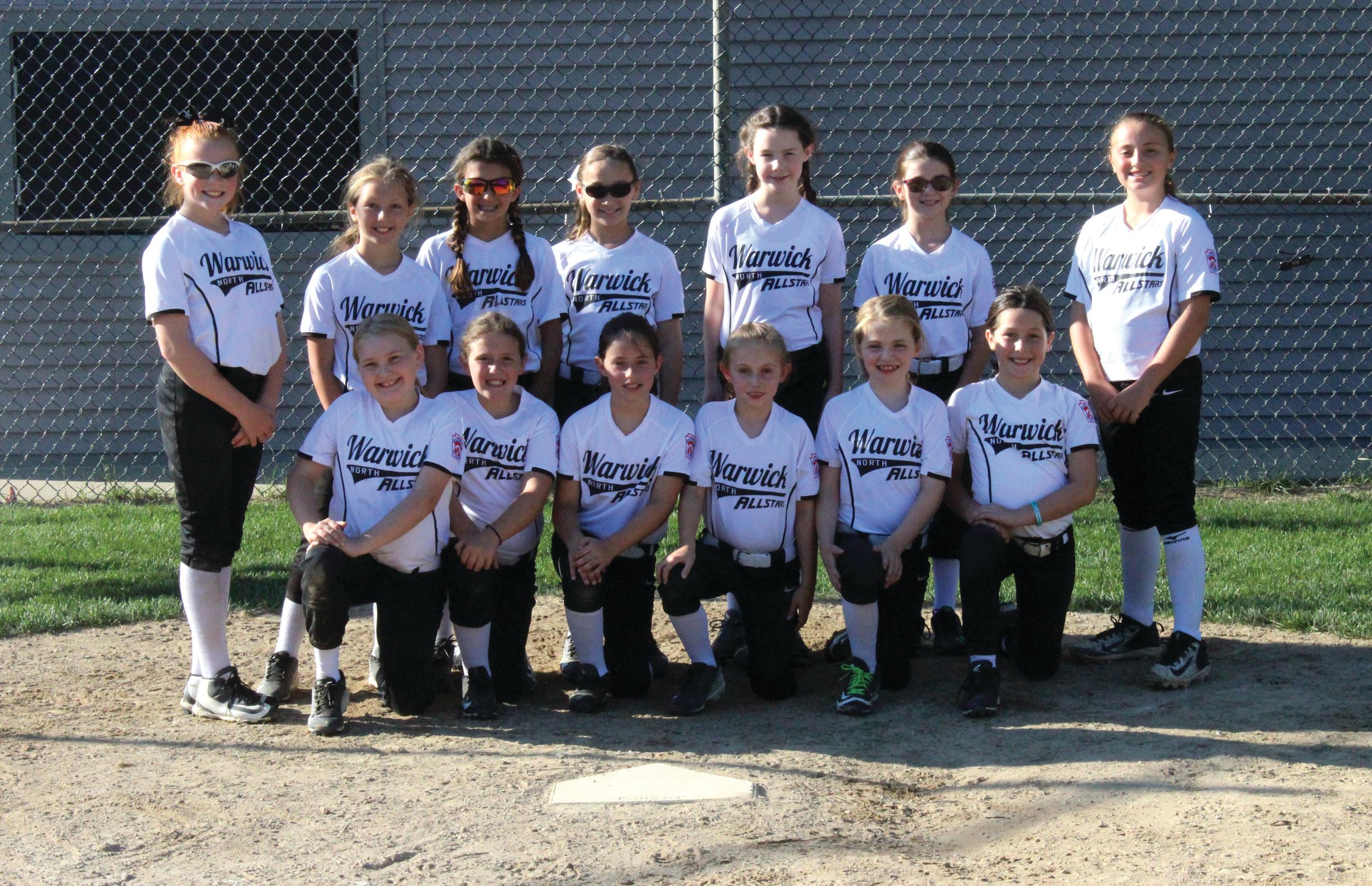 UNBEATEN: The Warwick North 8-10-year-old all-star team is currently in Pittston, Pennsylvania, competing for an Eastern Regional championship. Above, Warwick North poses for a team photo last Wednesday at Bend Street Complex. The team includes: Caitlin Trainor, Gretchen Dombeck, Avry Dewar, Reagan Motta, Emma Lemoine, Genna D'Amato, Holly Cameron, Mia Boyajian, Emma Burr, Hannah Fitzpatrick, Jaedyn Miga, Alivia Cota and Adrianna Pettinato.