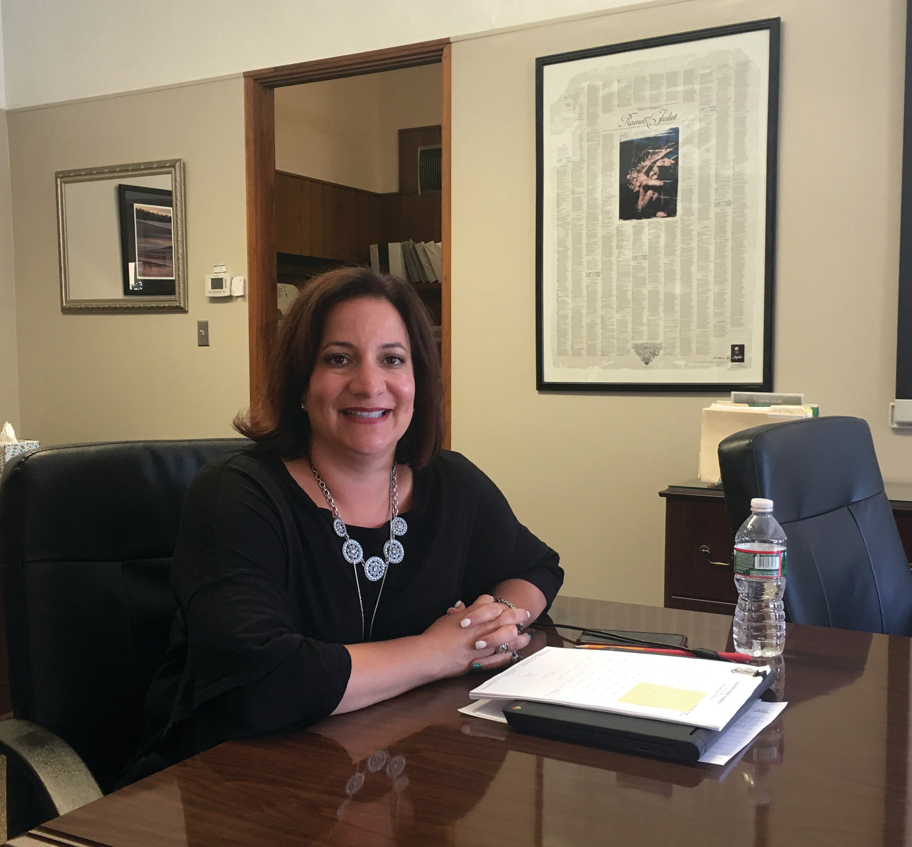 CLOSE TO HER ROOTS: Cranston Superintendent Jeannine Nota-Masse, a former English teacher, has a poster with the entirety of Romeo and Juliet on the wall in her office.