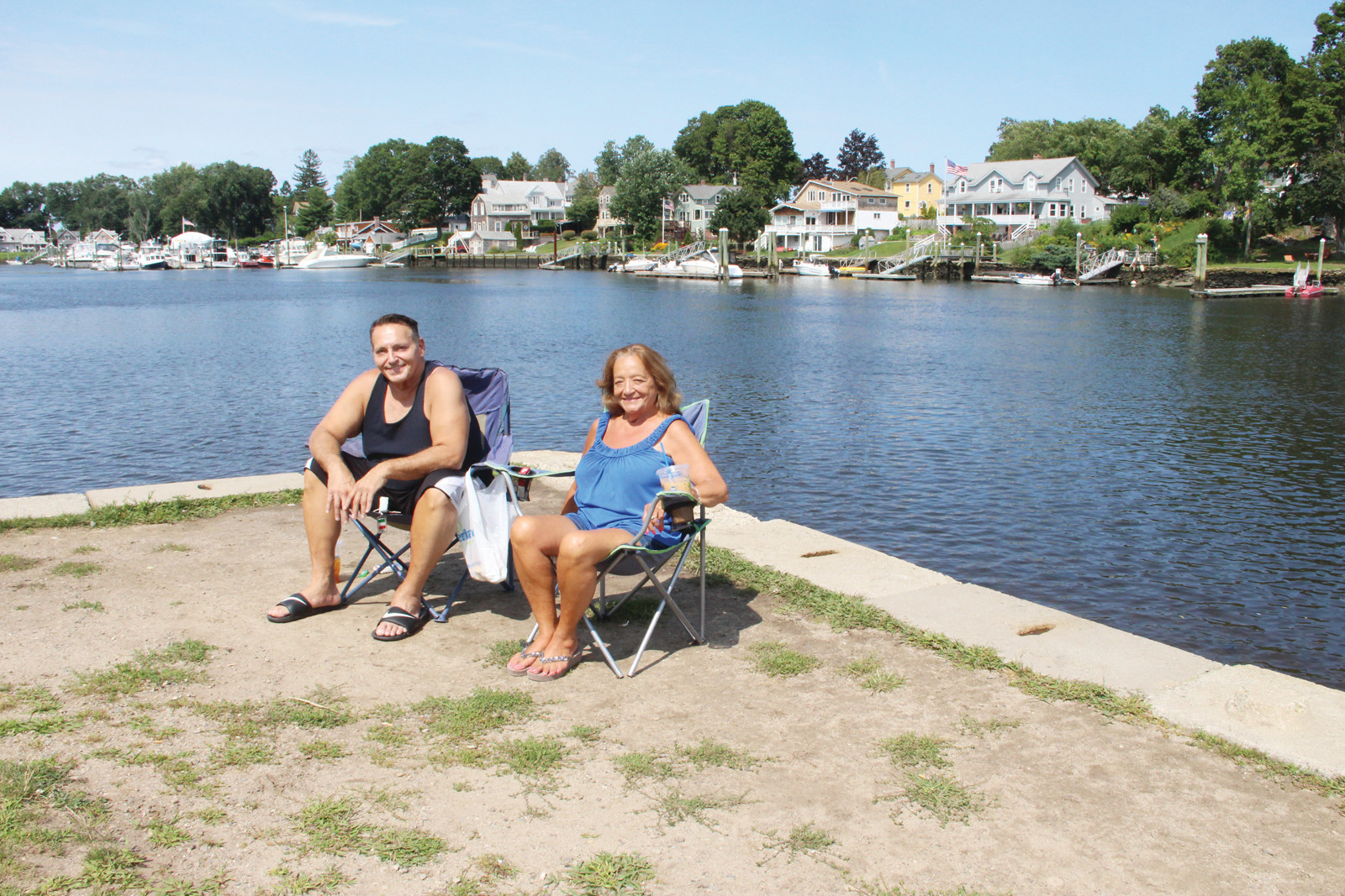 REGULARS: Albert Sionni and Joyce Harris take in the sun from the terrace at the Aspray boathouse. They said they frequently visit the spot.