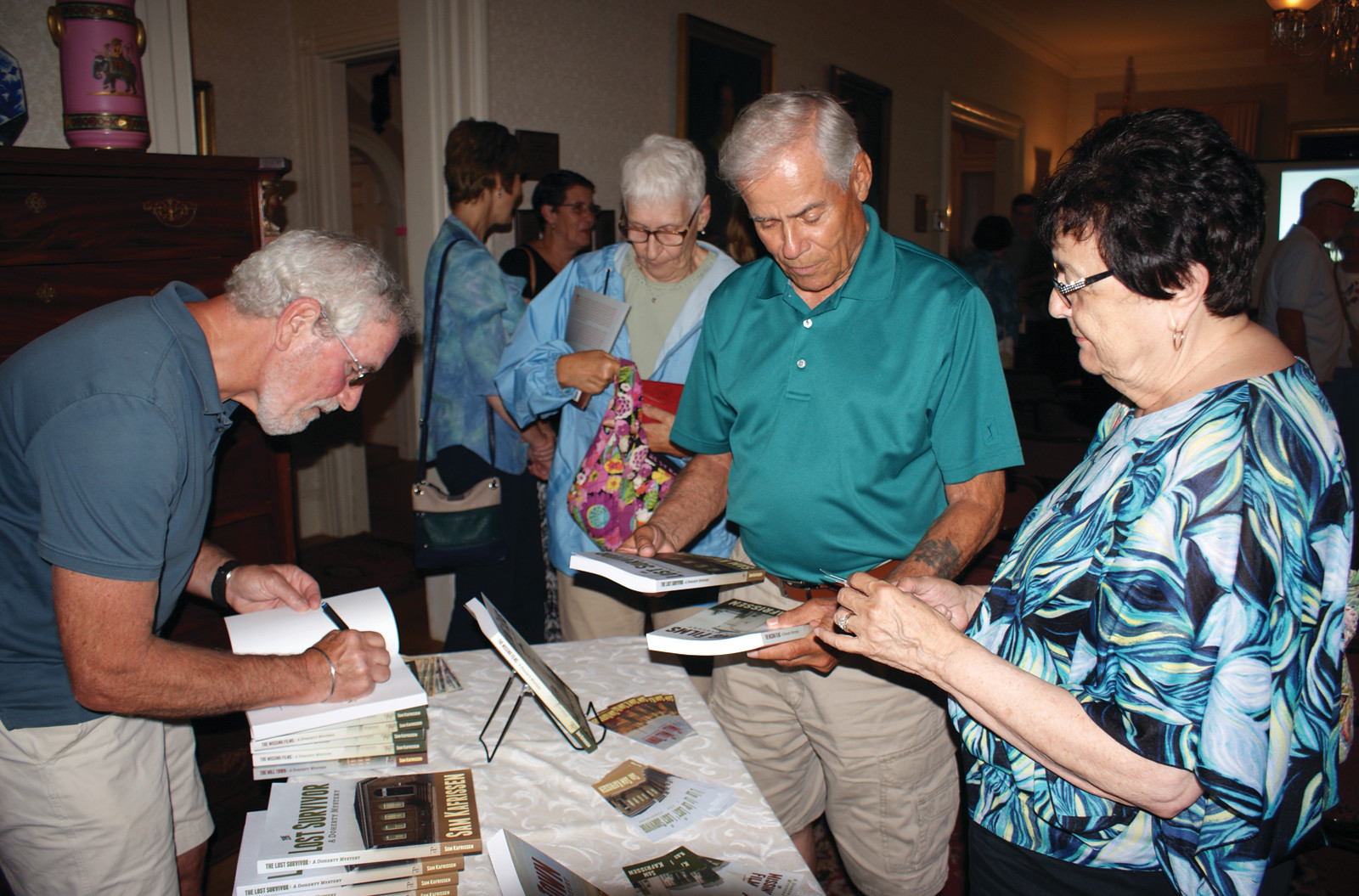 BOOK SIGNING: Pictured is author Sam Kafrissen signing books for Rudy and Marie Sanda.
