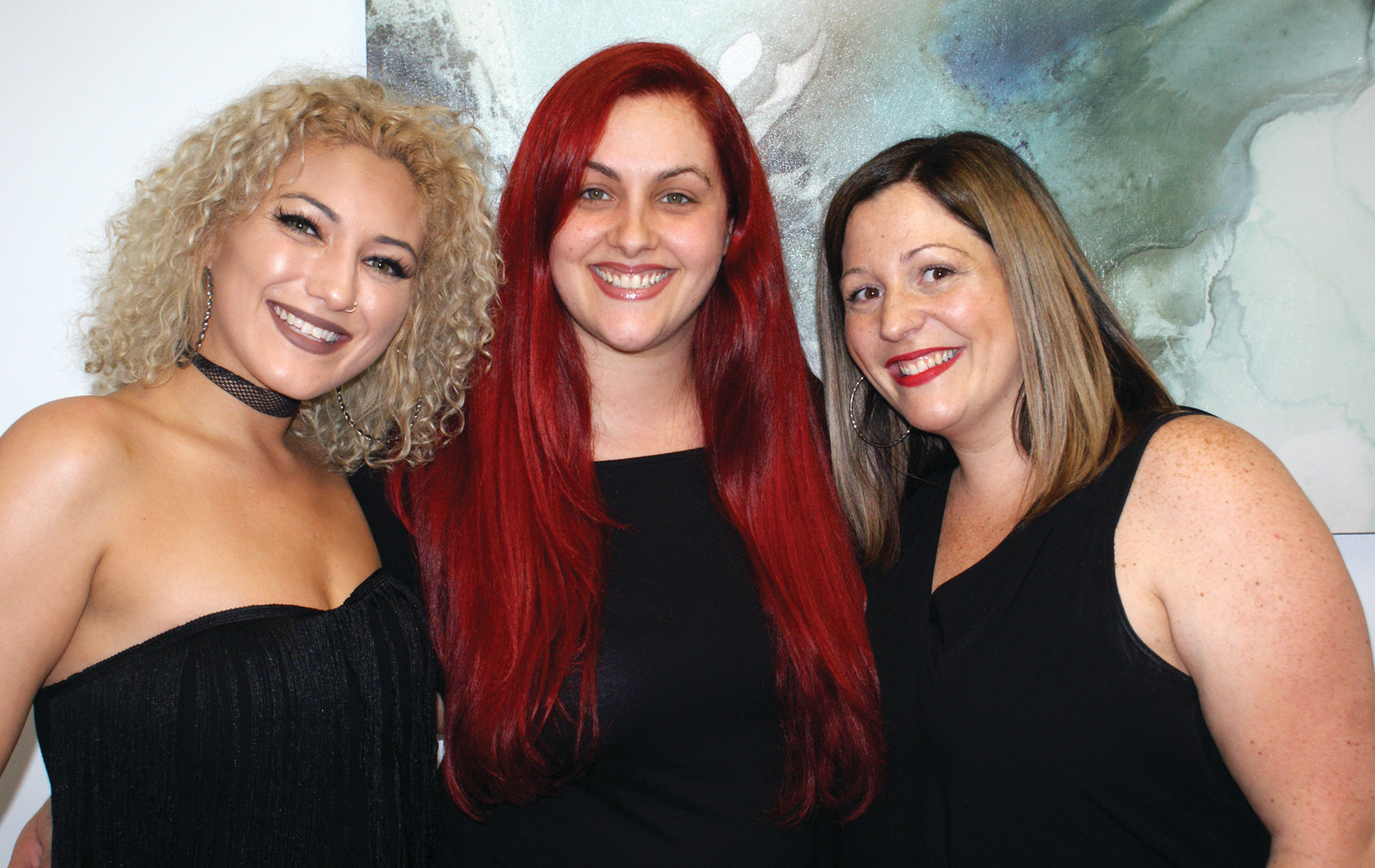 Pictured in the middle is owner Samantha Frew who is pictured with hairstylist Tess Cabral and Nail Tech Nicole Bucci.