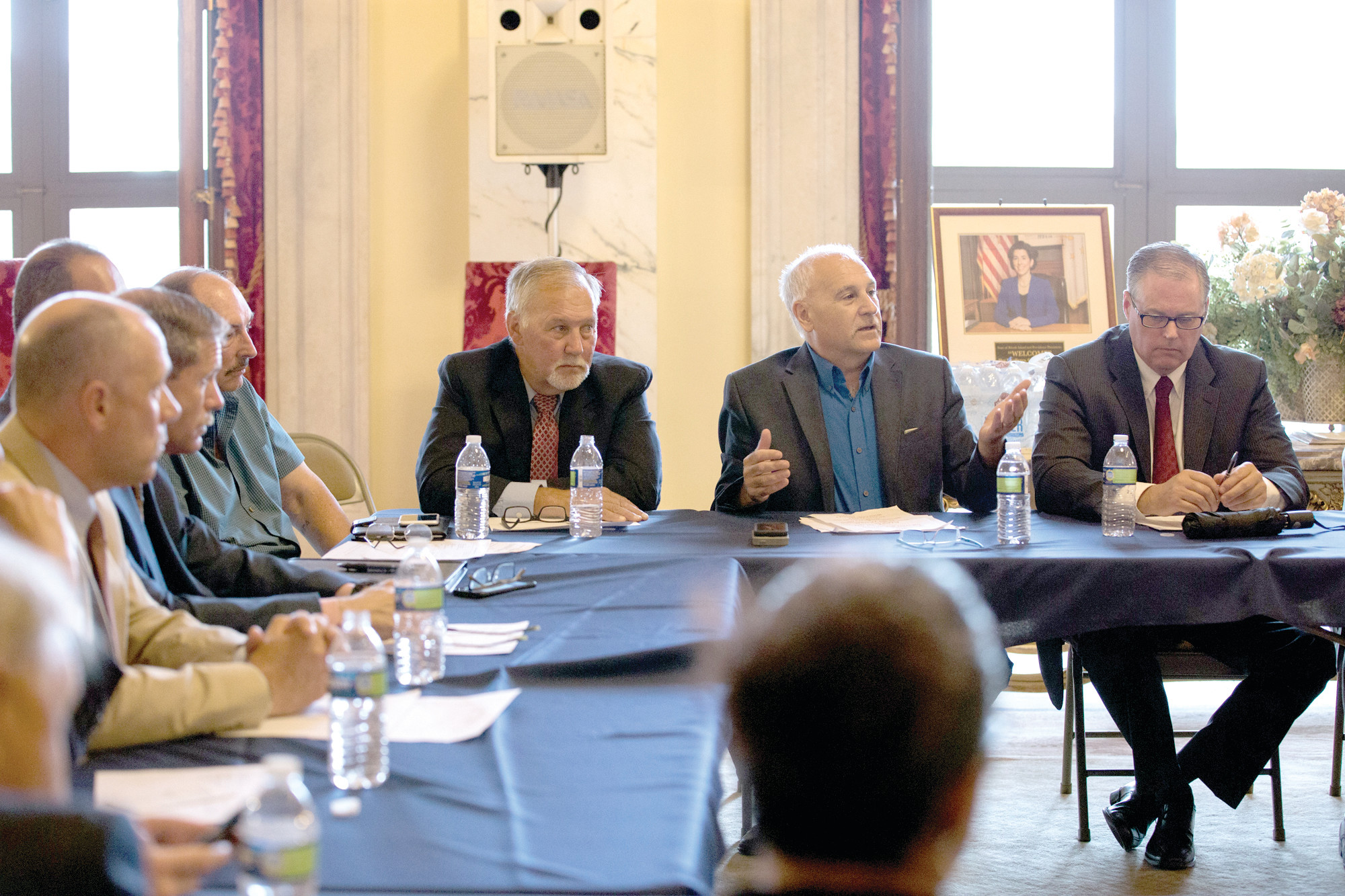 IMPASSE RESOLVED: Mayor Joseph Polisena joined other town administrators and mayors at a meeting recently convened by Governor Gina Raimondo regarding the legislative budget impasse.