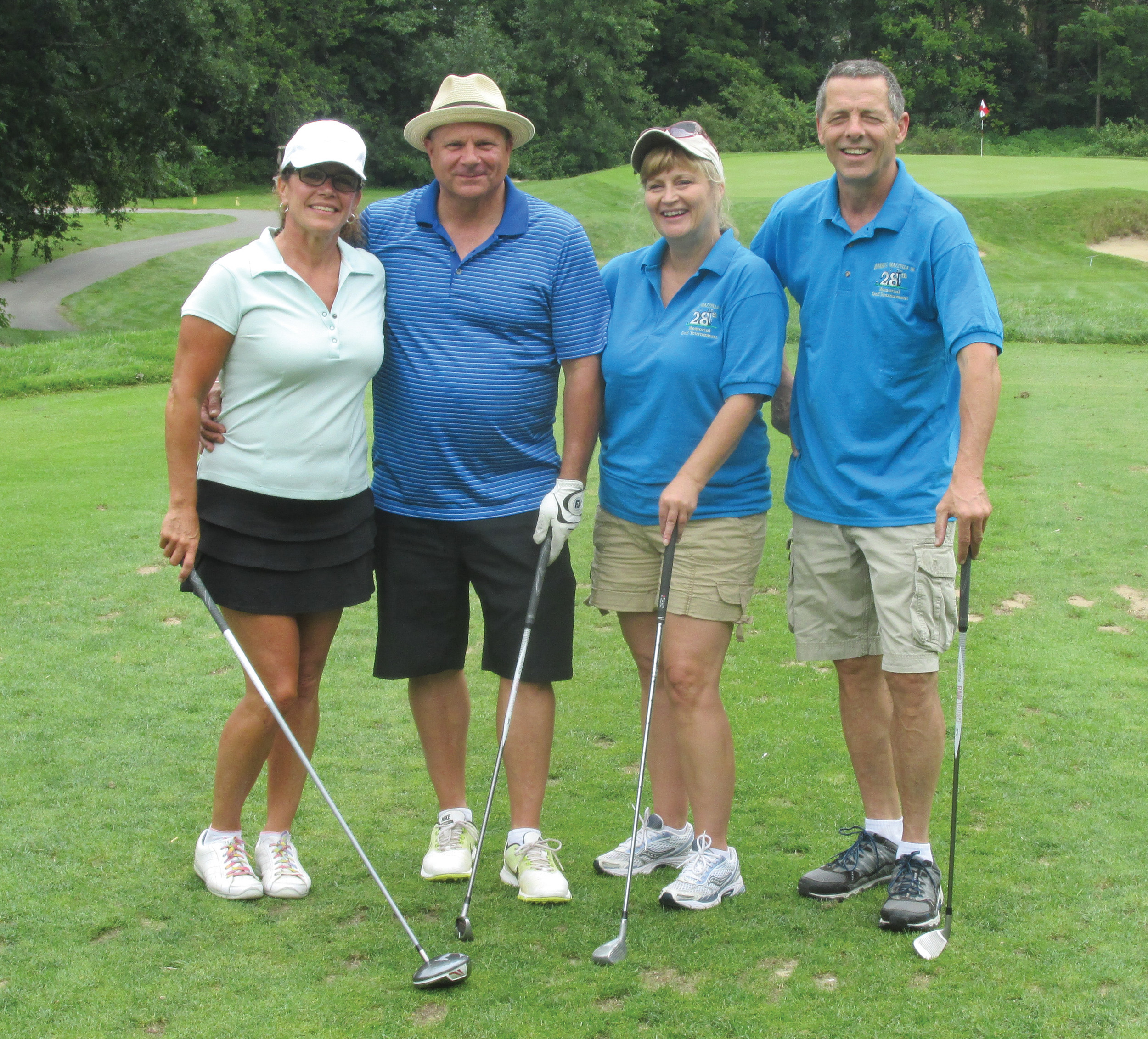 MIKE'S MATES: Mike Mazzulla (right) is joined by Lisa DeChristofaro, Paul Cerulo and Robin Christensen at Triggs Memorial Golf Course in Providence, where the 30th annual Daniel E. Mazzulla Sr. Golf Tournament was recently played.