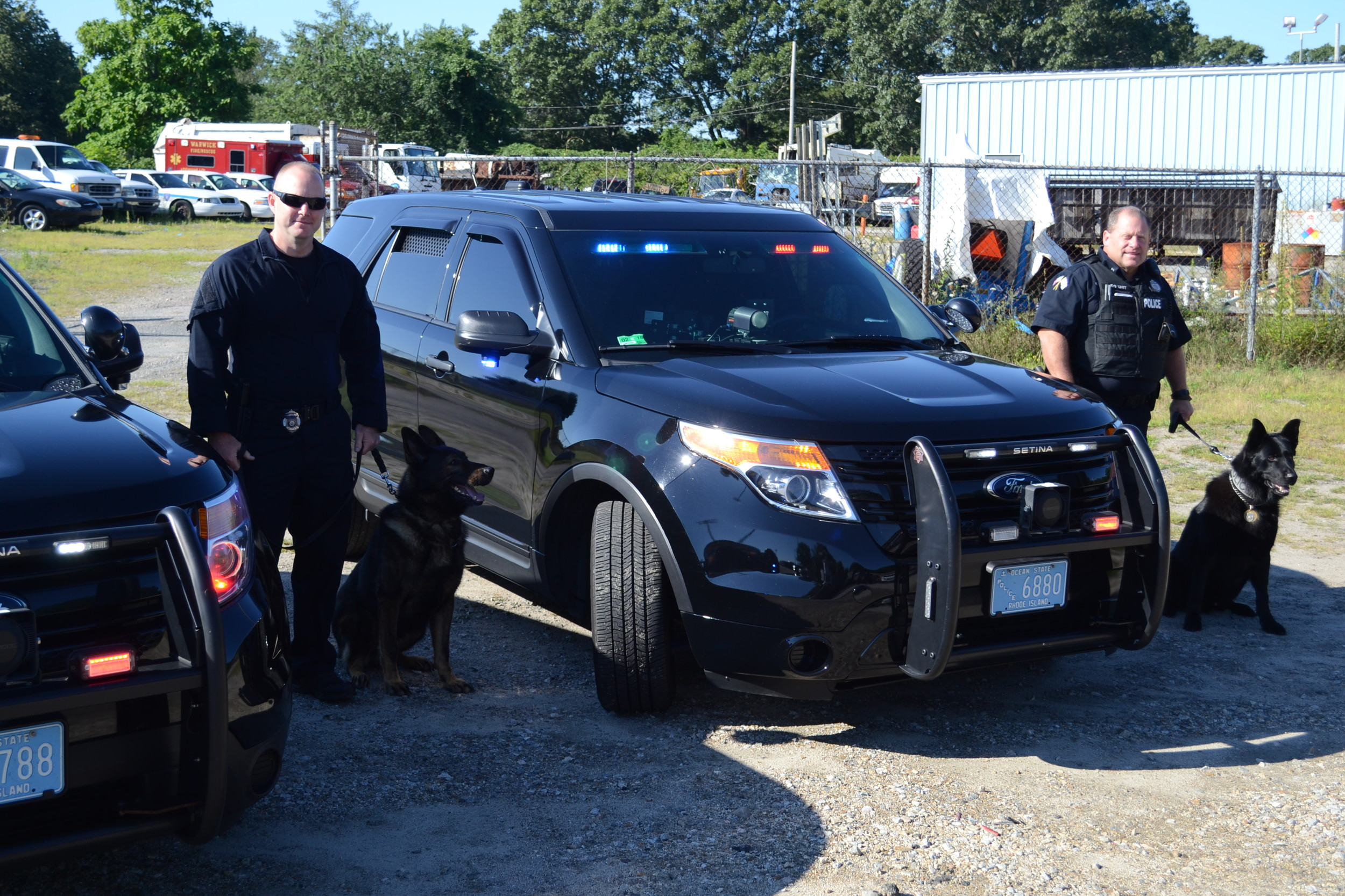 K-9 officers Aaron Steere and Paul Wells with their K-9 partners, Viking and Fox.