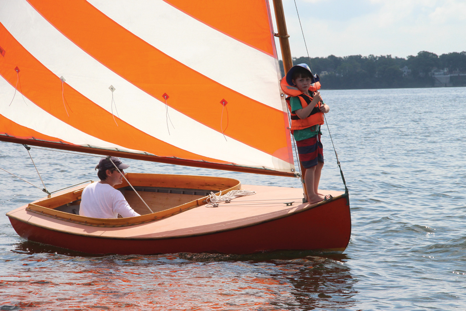 FIRST MATE: Tim Fallon and his 5-year-old son Ben sailed their Beetle Cat Reminder to a first place finish in the weekend regatta hosted by Edgewood Yacht Club.