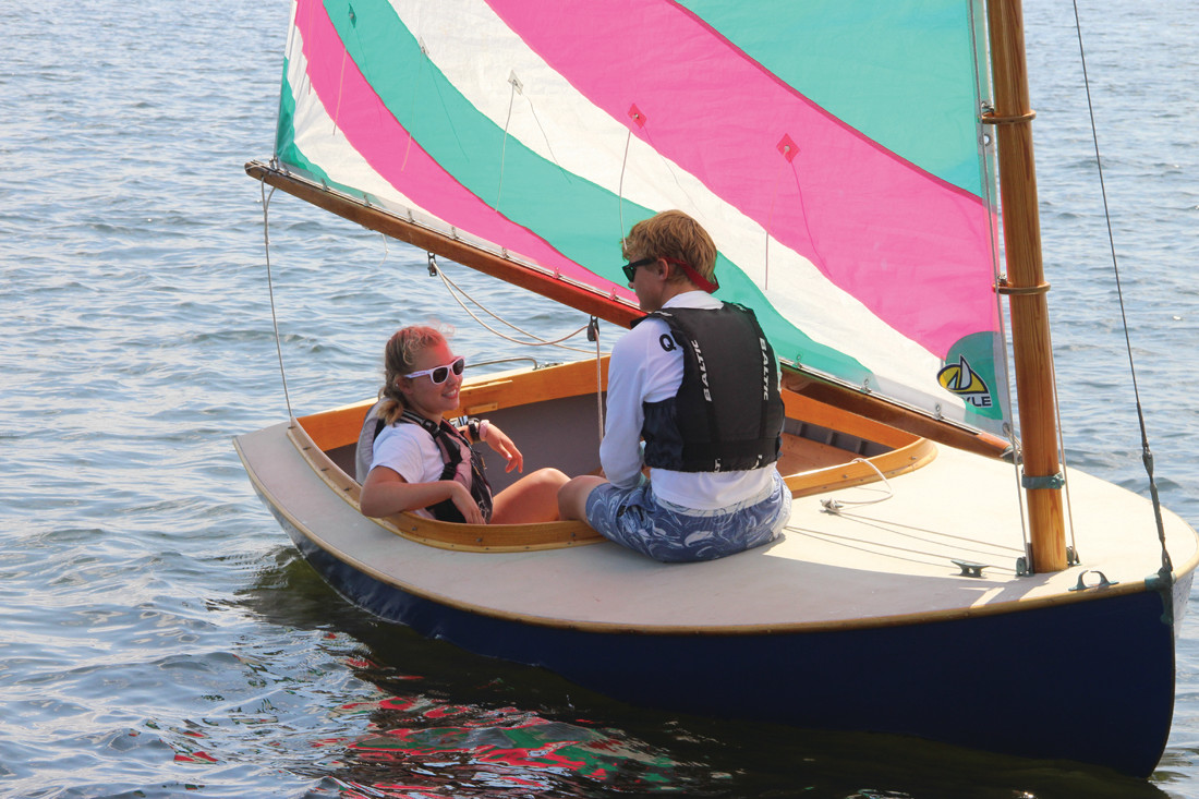 SHE'S THE SKIPPER: Greta Shuster and Henry Lee hang out for the start of another race.