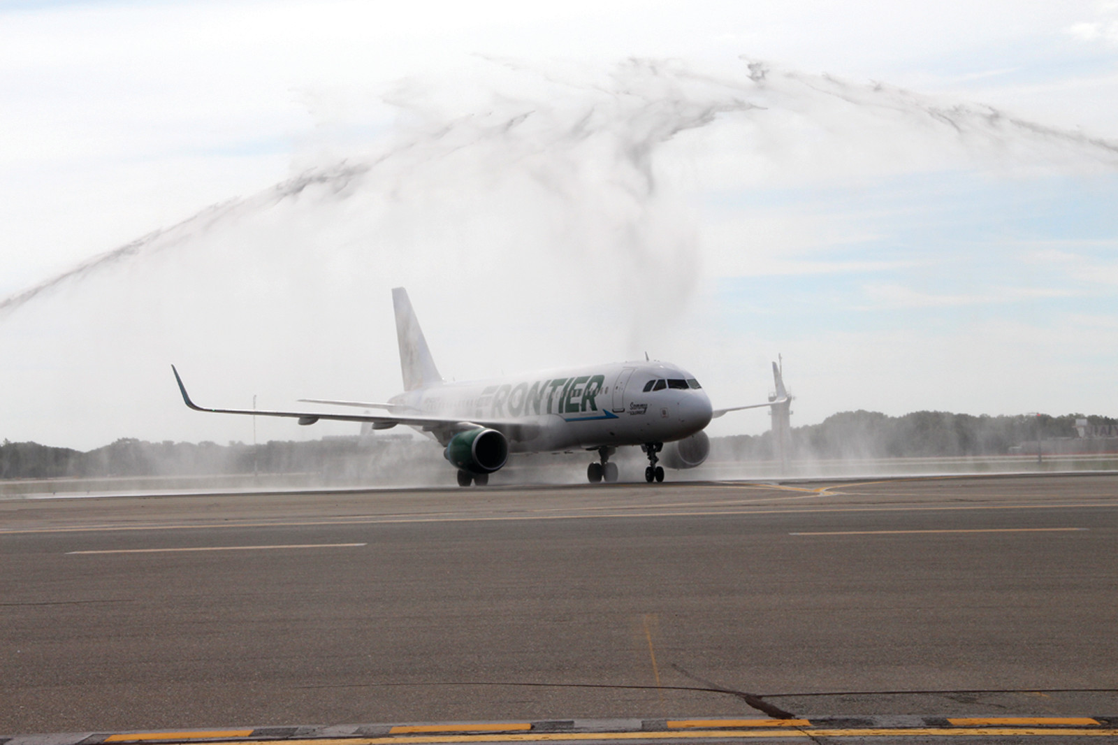 GIVING IT A SPLASH: Frontier flight receives a water cannon salute upon arrival to Green Airport.