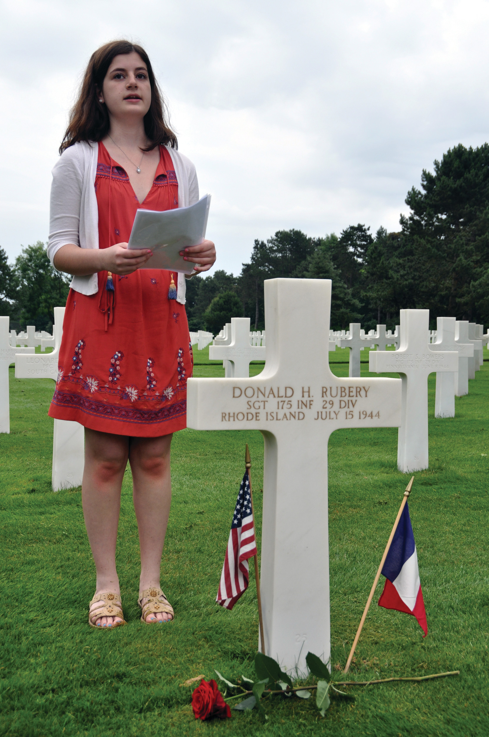 IN MEMORIAM: Rebecca Carcieri delivers a eulogy at the gravesite of Sergeant Donald H. Rubery on the grounds of the American Cemetery in Normandy, France.