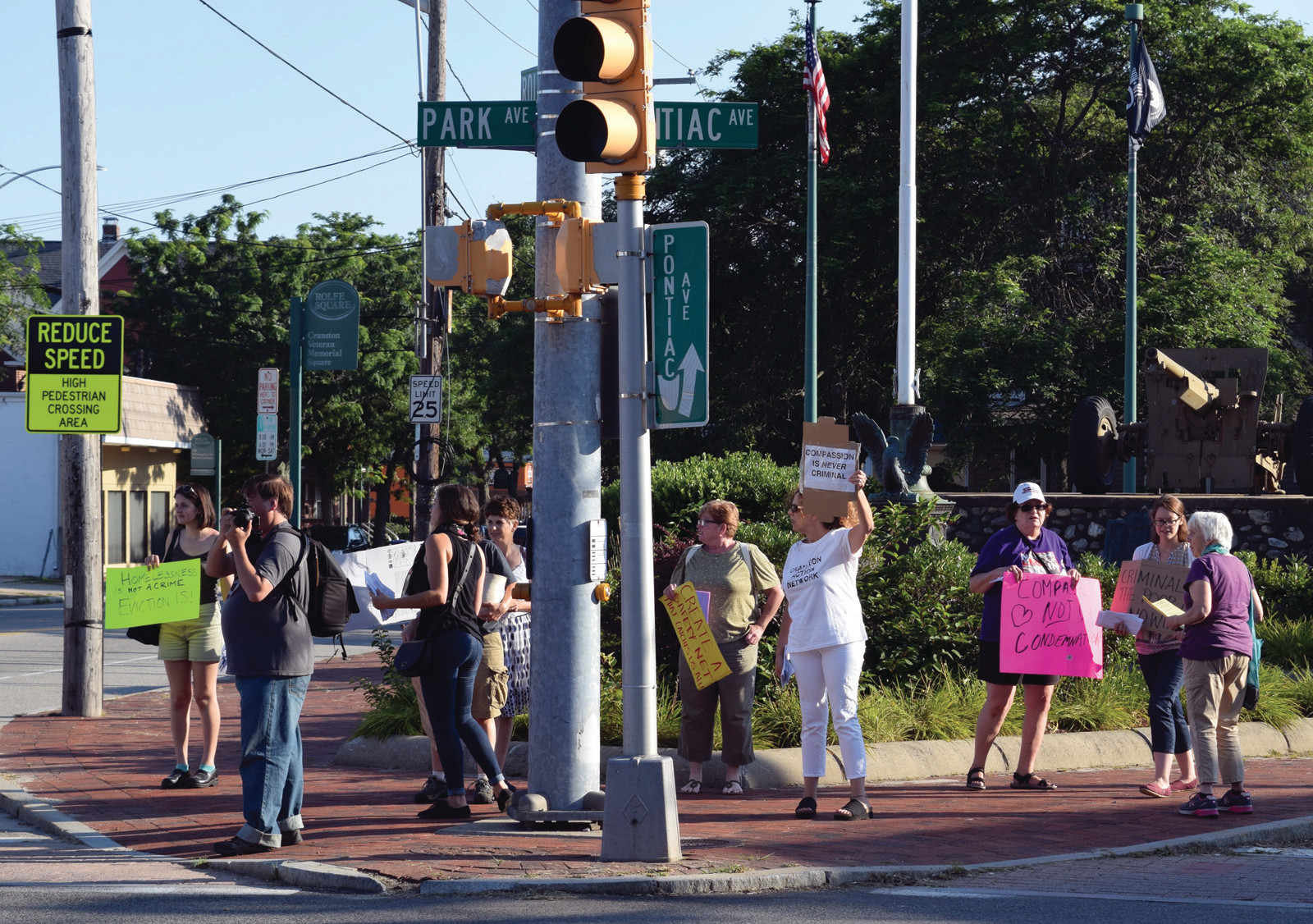 AT A CROSSROADS: Protesters gathered at the intersection of Pontiac Avenue, Park Avenue and Rolfe Square to speak out against the Cranston panhandling ordinance.