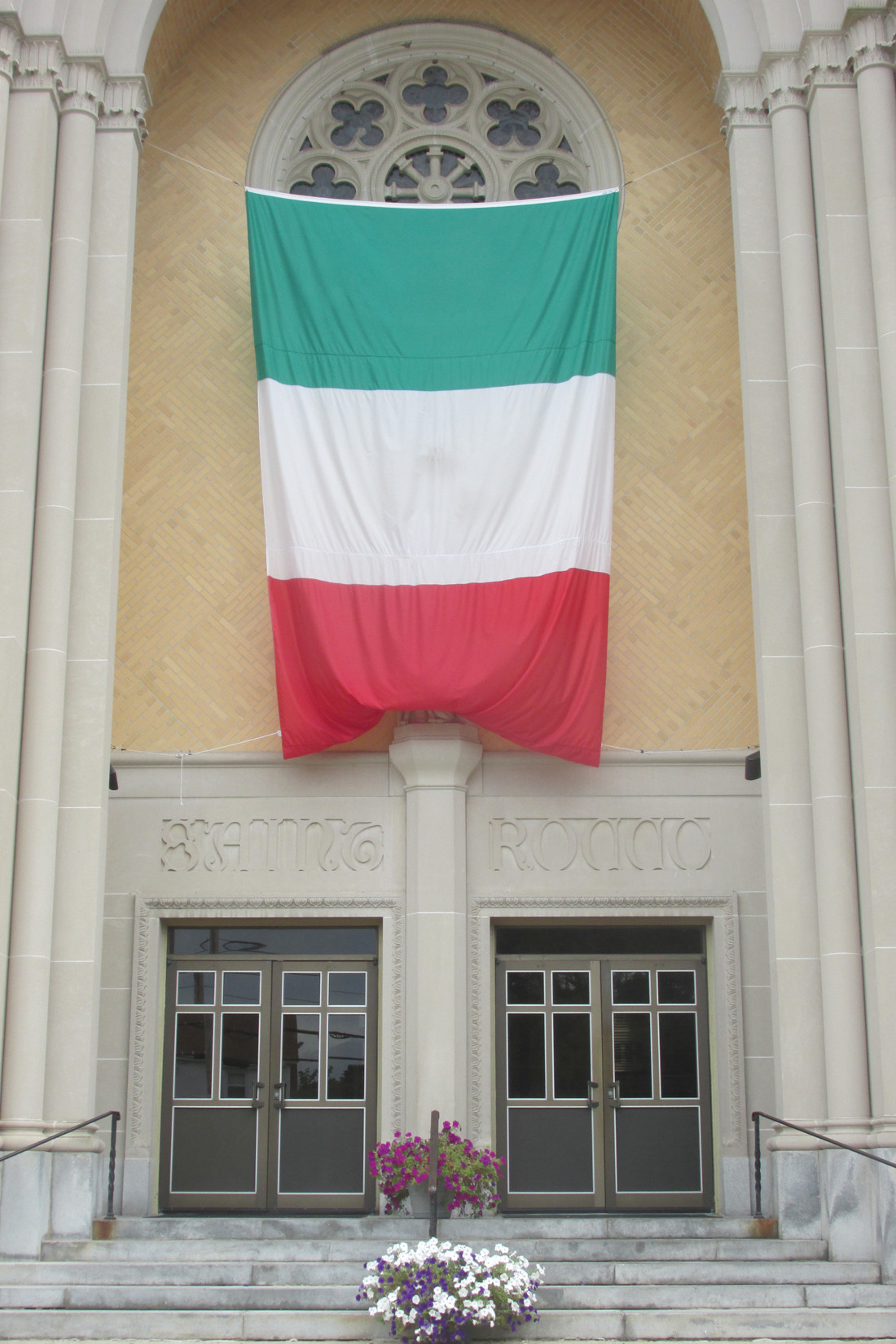 FANTASTIC FLAG: This is the huge Italian flag that's draped over the entrance to Saint Rocco Church at 925 Atwood Ave. and is the signature sign for the parish's annual feast and festival.