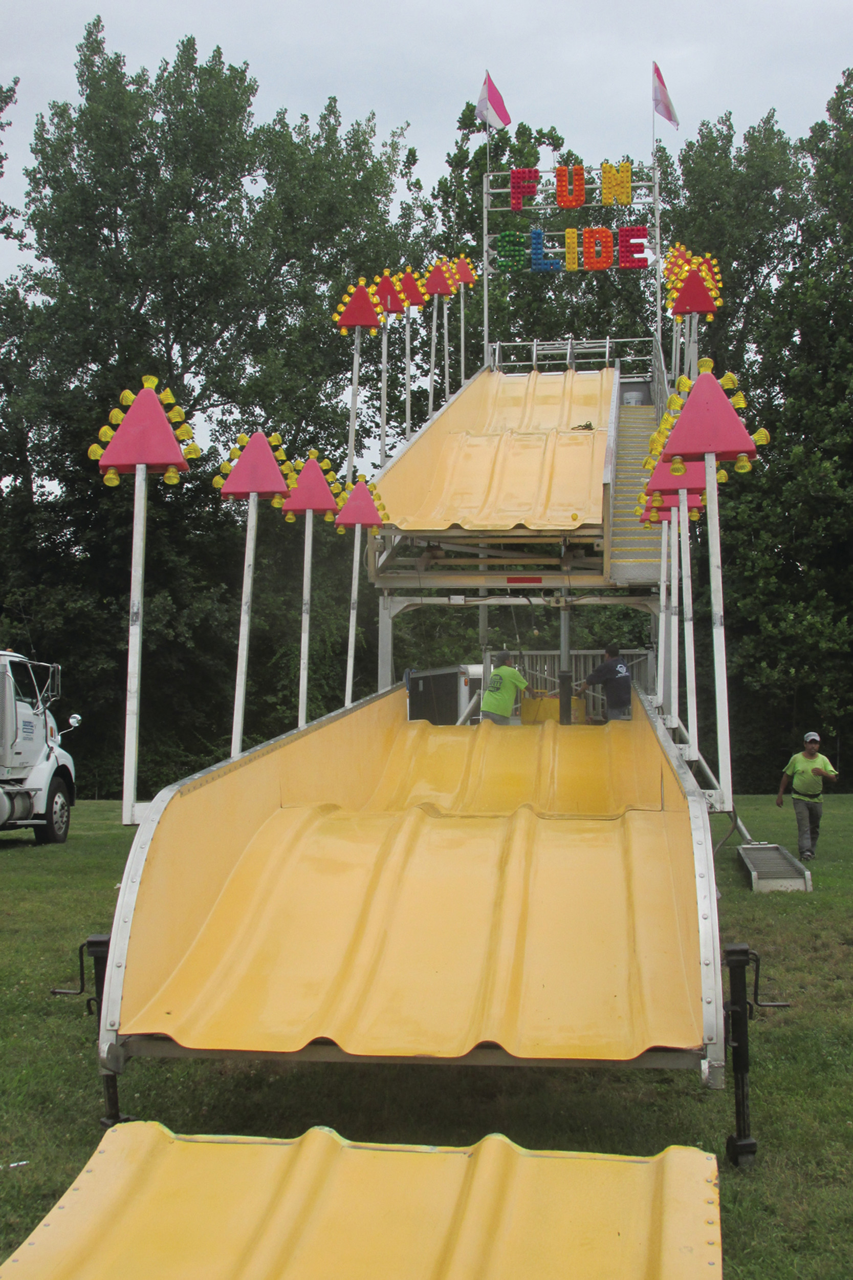 "SUPER SLIDE: This is the ""Fun Slide"" that Rockwell Amusements staffers were setting up Tuesday at Festival Field behind Saint Rocco Church for this weekend's feast celebration."