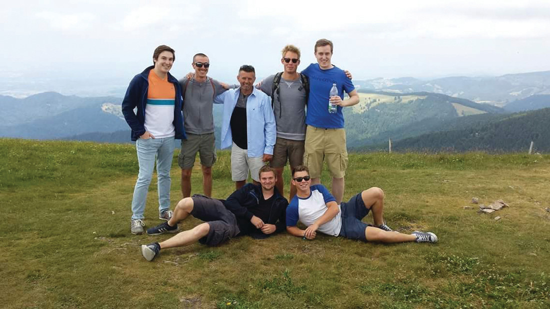 50th BIRTHDAY IN GERMANY: Robert Monahan enjoys the view with the foreign exchange students that he hosted. Pictured from left: Alessandro DeBiasi, Jacopo Fassi, Robert Monahan, Eric Martin, and Max Krebs. Bottom row from left: David Andres and Kai Martin.