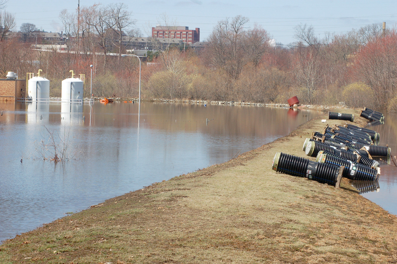 MOTHER NATURE'S FURY: A historic flood filled the 15-acre site with tens of millions of gallons of stormwater and untreated wastewater, which caused a total of $14 million in damages. The levee, which was designed to keep water out, actually made it more difficult to get the water out once it had crested the hill.