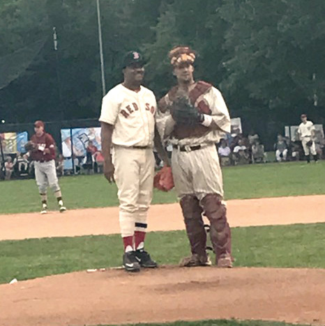 CATCHING FOR A LEGEND: , Gian Martellini talks with Pedro Martinez before the start of an inning last week.