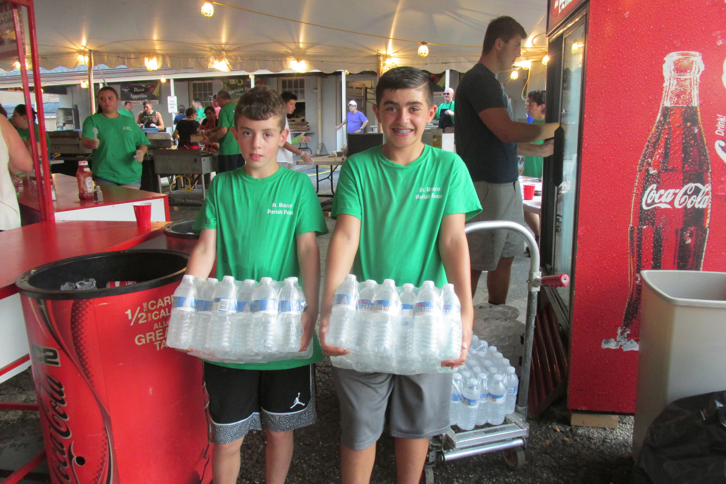 HELPING HANDS: Youngsters like Matt Pingatore and Jack Mooradian provided much valuable help by keeping the bottled water on ice during Sunday's Feast and Festival in Johnston.