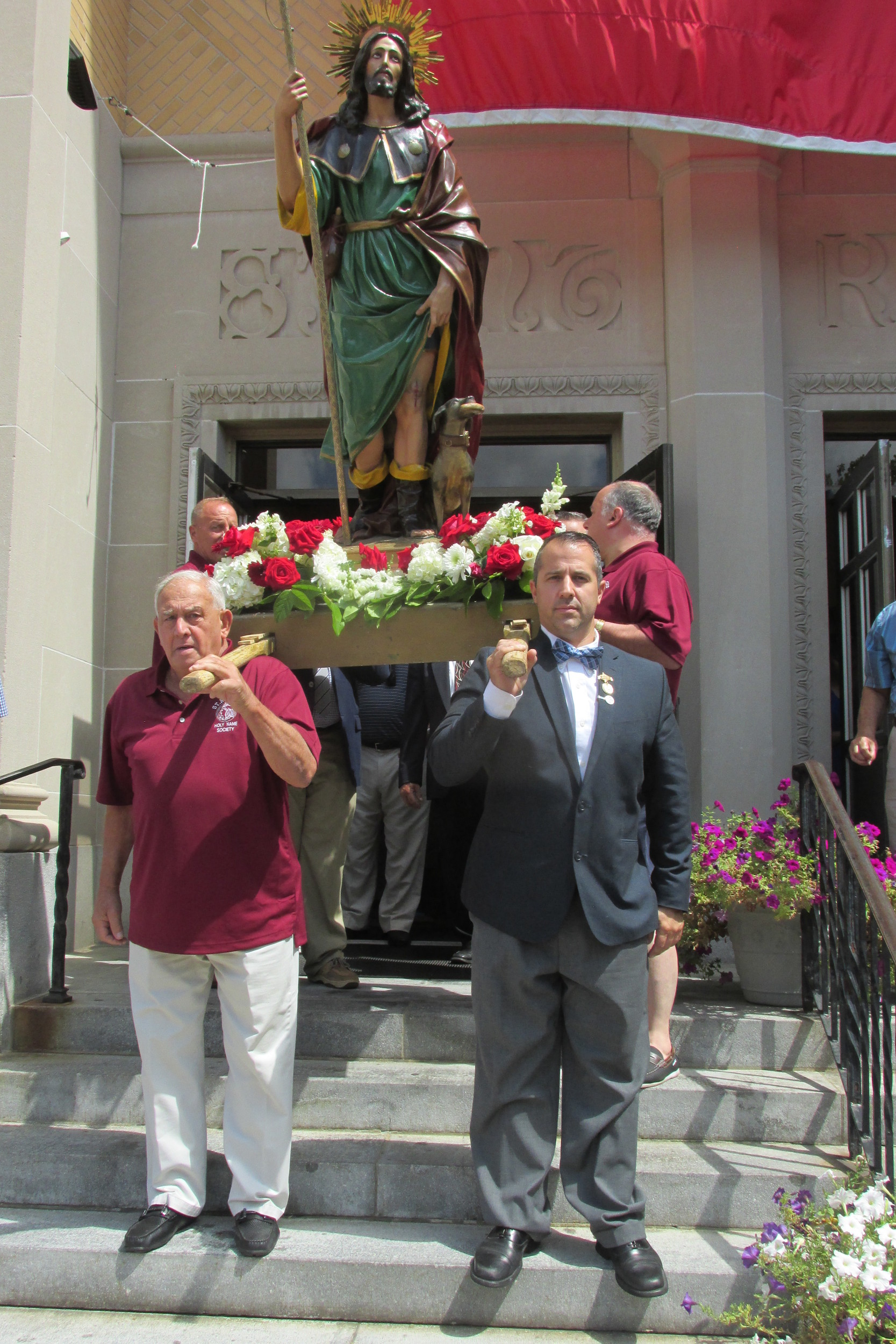 SPECIAL SCENE: Joe DeBenedetto and Al Lewis were the lead carriers of the Statute of Saint Rocco during Sunday's sun-covered procession that is a Rite of the parish's annual Feast and Festival.