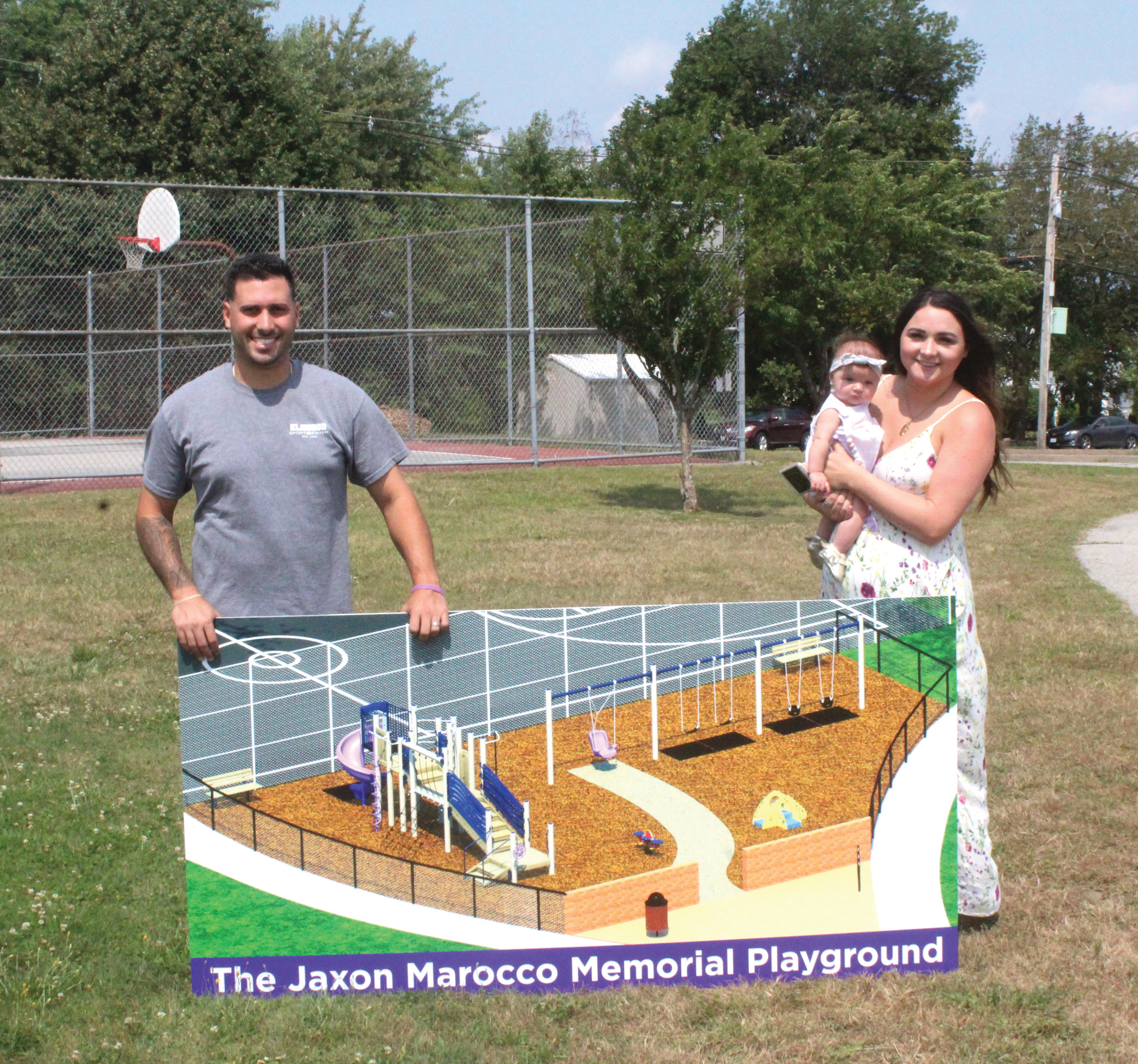 Mark and Tori Marocco, alongside their daughter, Landree, unveil their plan to construct The Jaxon Marocco Memorial Playground on Tuesday.
