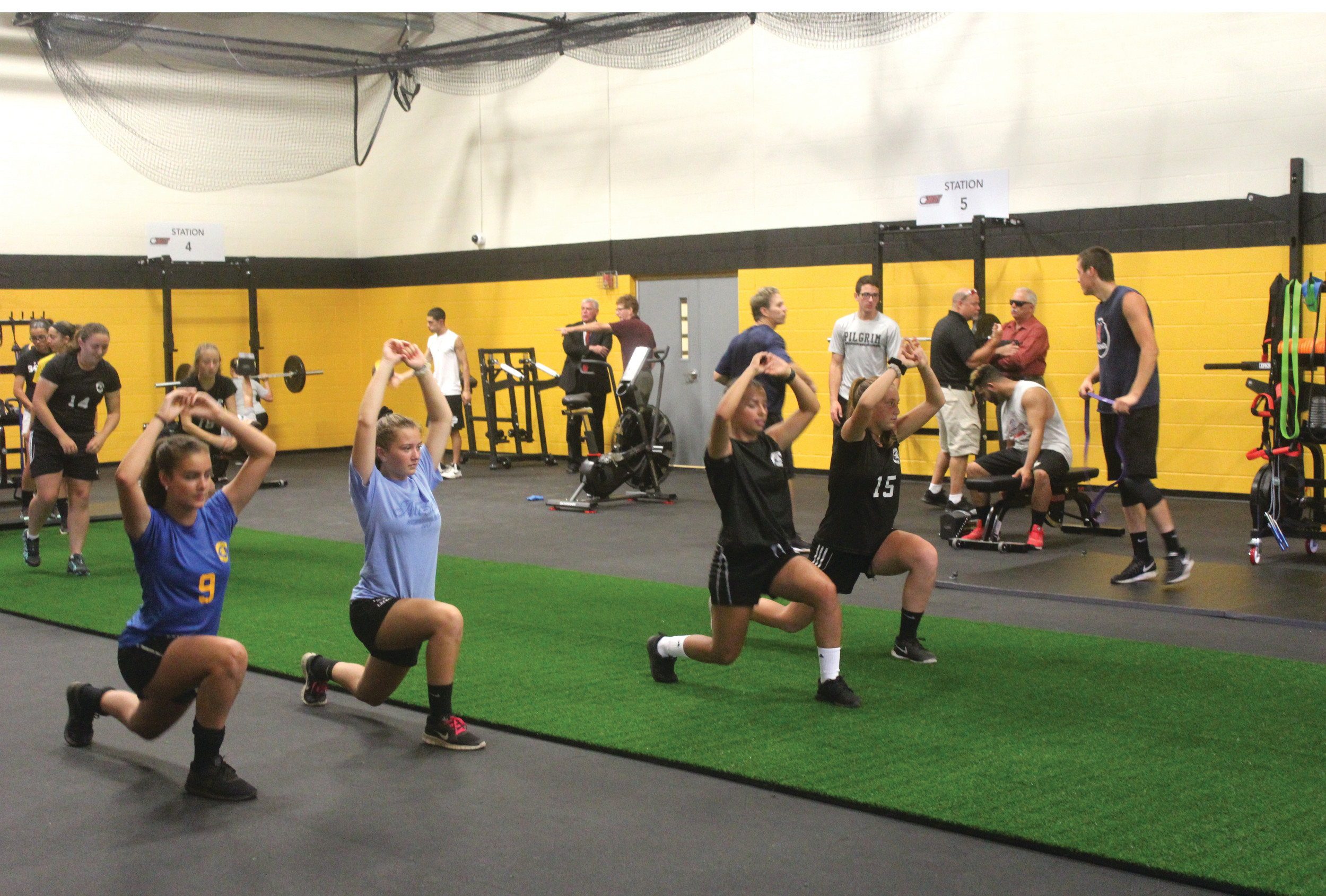Members of the Pilgrim girls' soccer team go through a series of dynamic warm-up exercises on Tuesday.