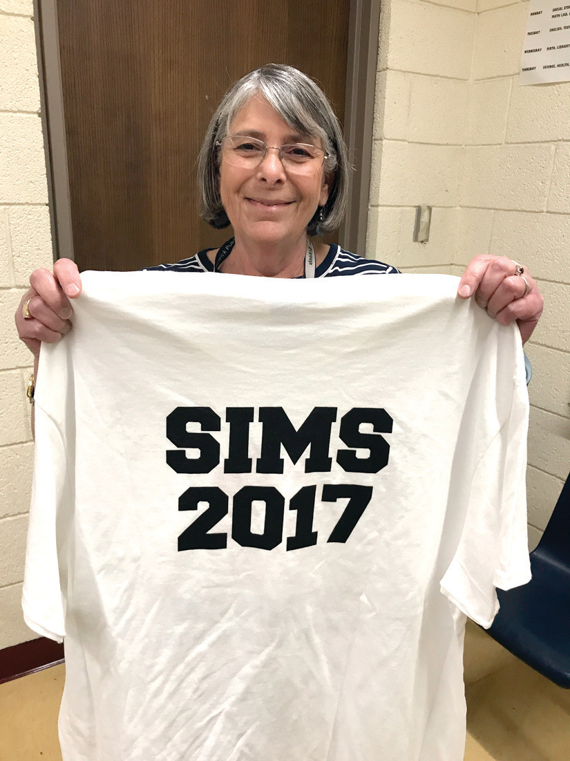 PROUD TO BE SIMS: Dr. Anne Siesel shows off the SIMS 2017 shirts. Students are encouraged to wear their shirts on the first day of school.